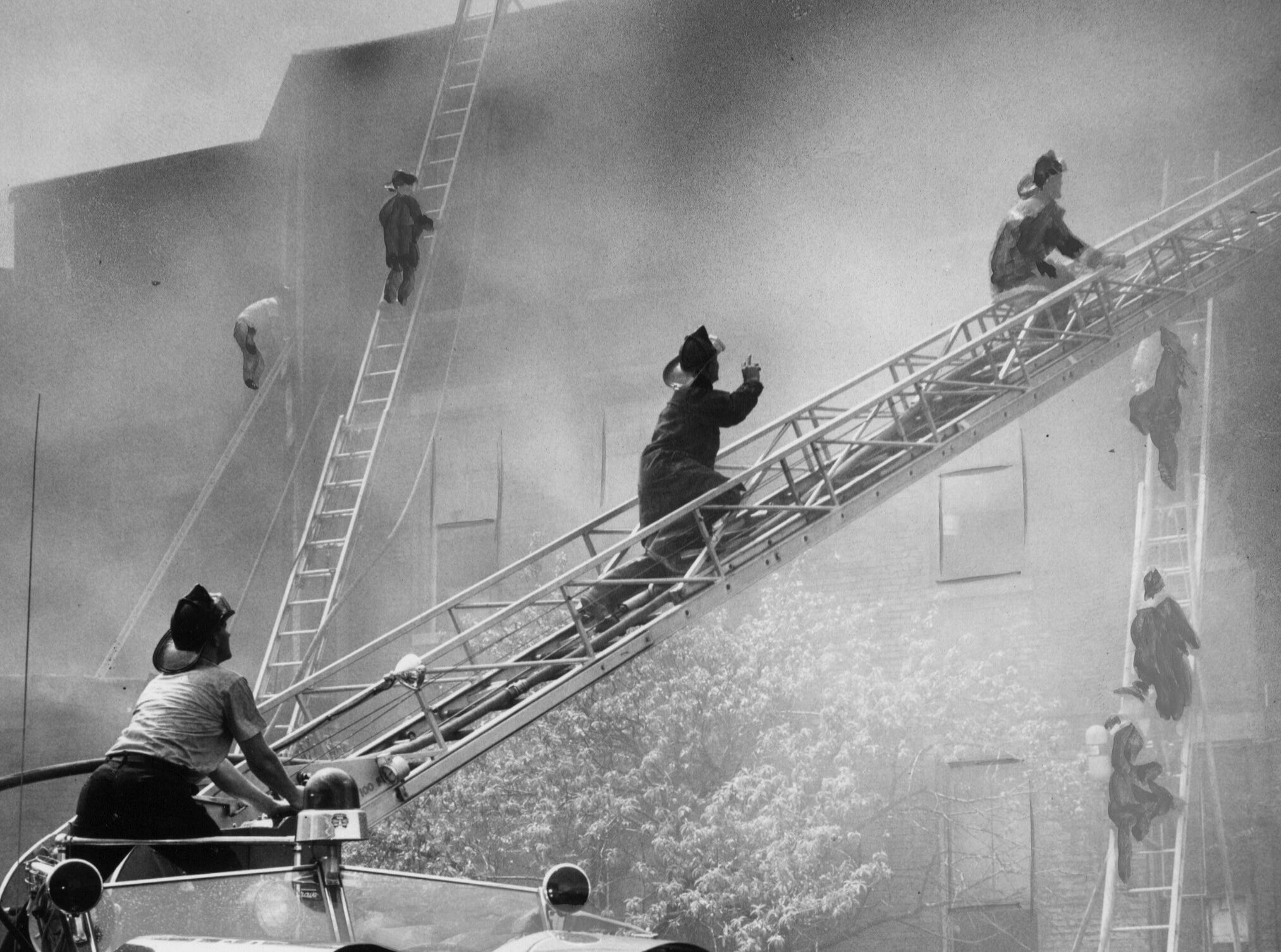 Firemen swarmed to the top of a vacant building, once the Waverly Hotel, to fight a blaze that began in a third-floor room. 