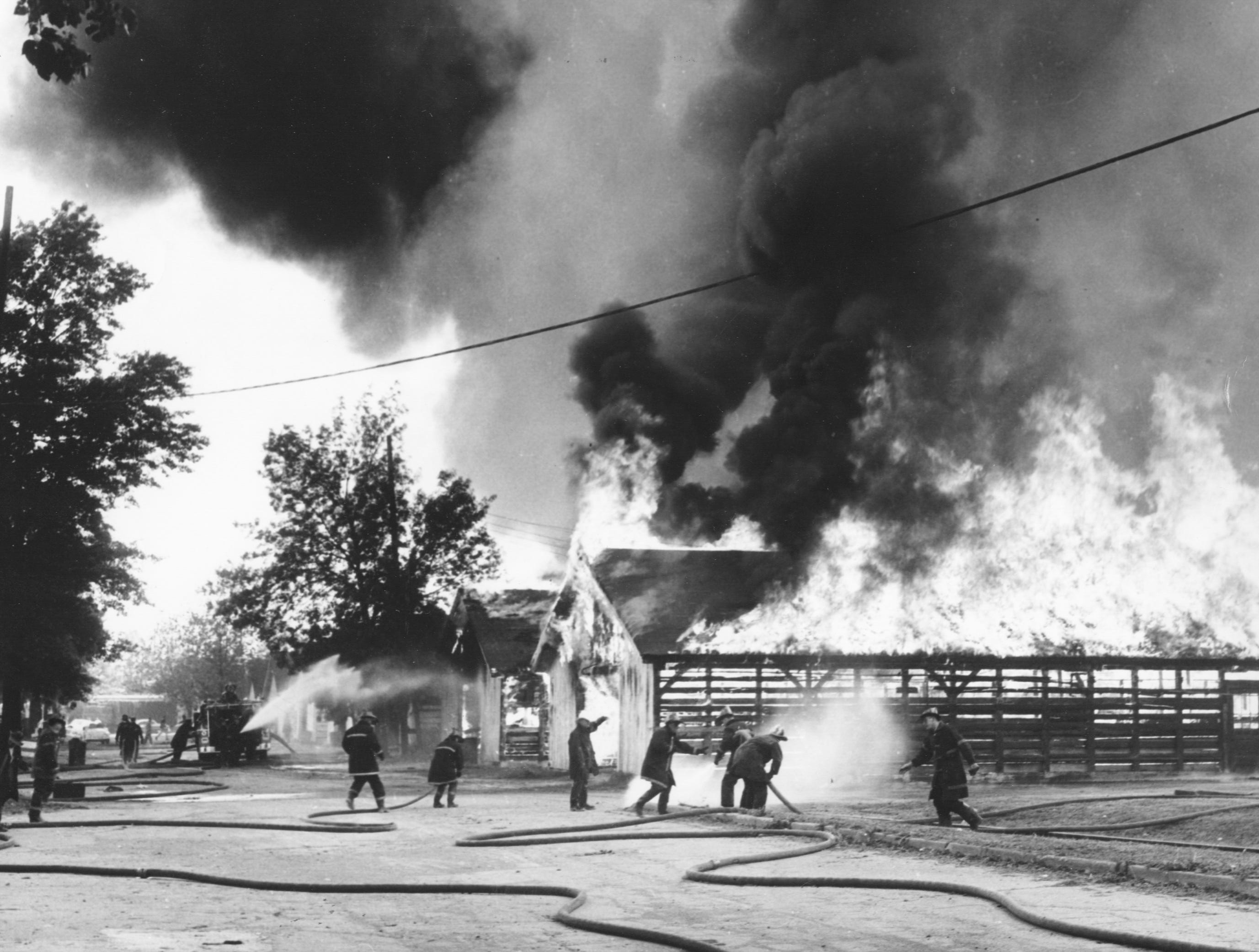 A fire at Miles Park killed 32 thoroughbreds and destroyed 13 barns. 