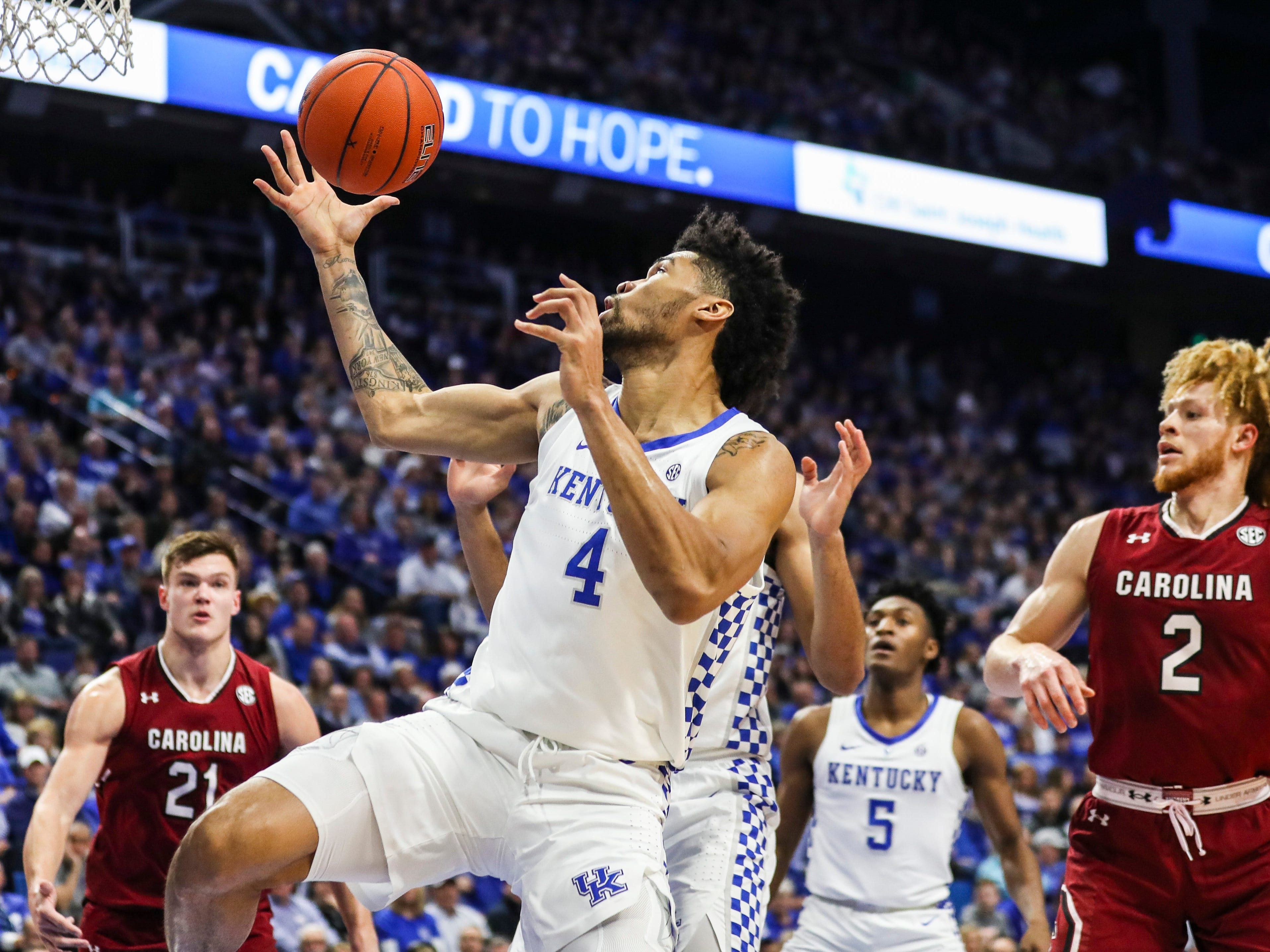 Kentucky's Nick Richards pulls down a rebound in the first half Tuesday night against South Carolina at Rupp Arena. Feb. 5, 2019