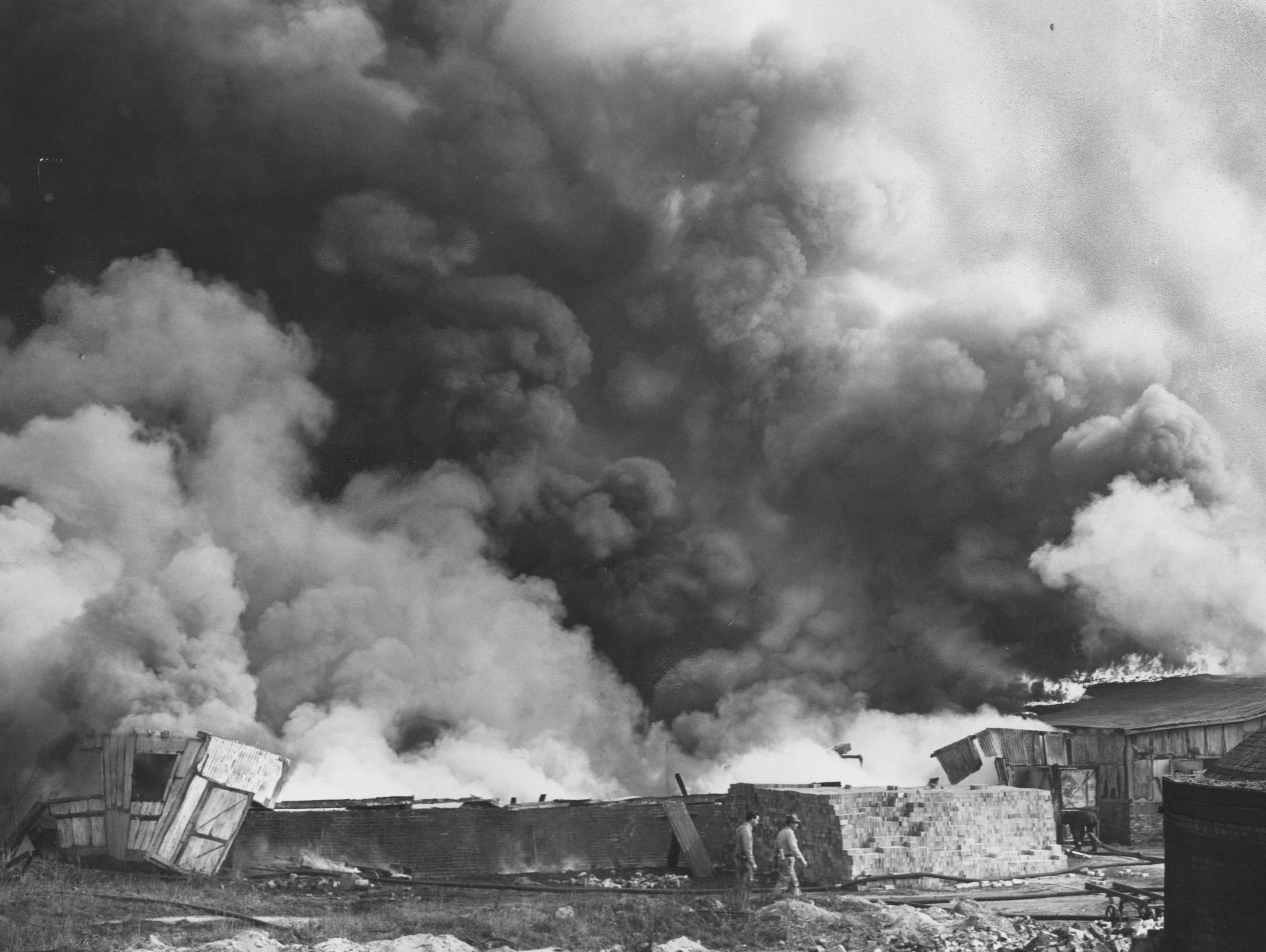 Dense smoke clouds rise from the fire-swept Louisville Fire Brick Works. 