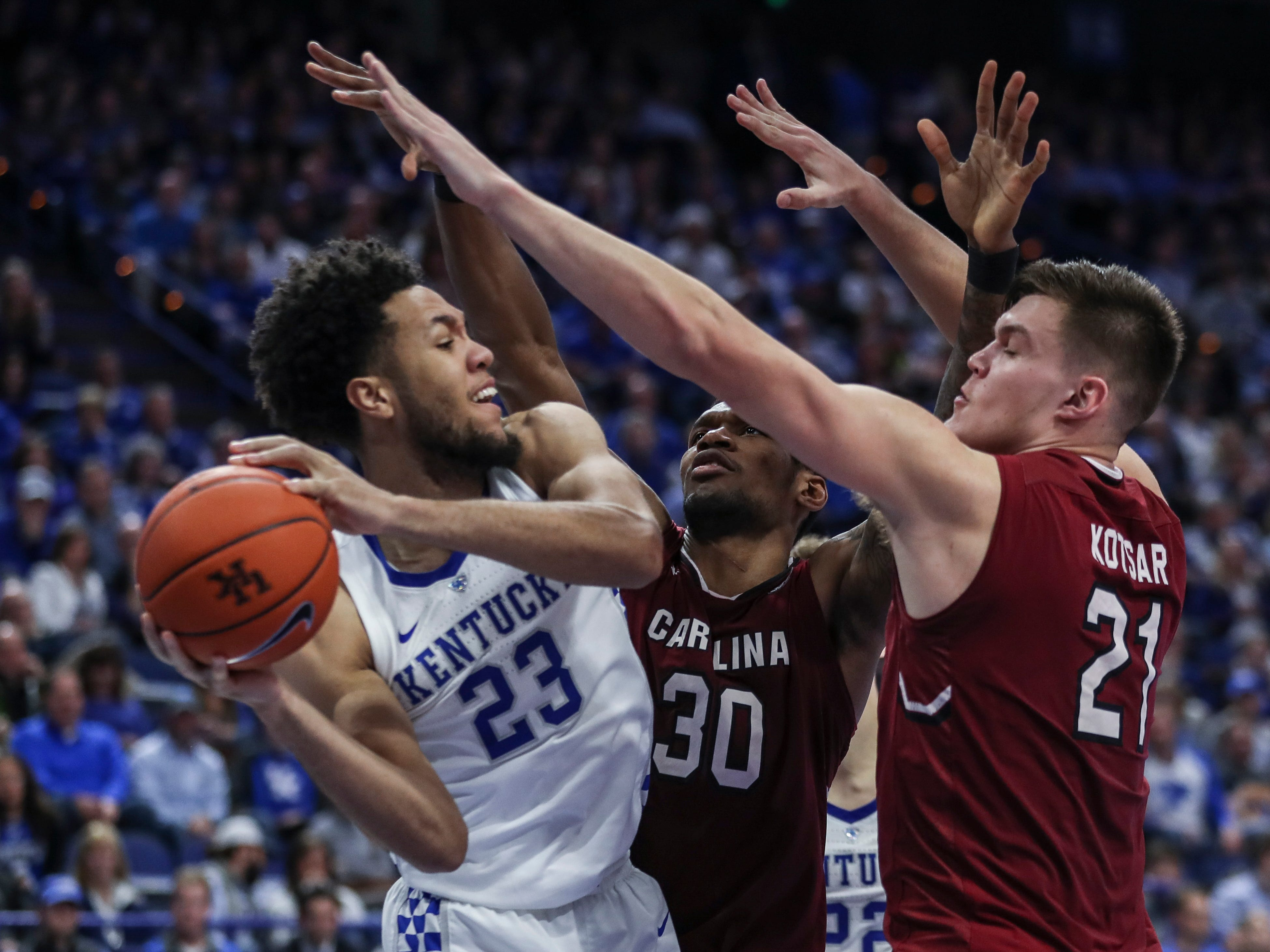 Kentucky's EJ Montgomery looks to pass under pressure from South Carolina Tuesday night. He had a season high 11 points with 13 rebounds in the 76-48 win.  Feb. 5, 2019