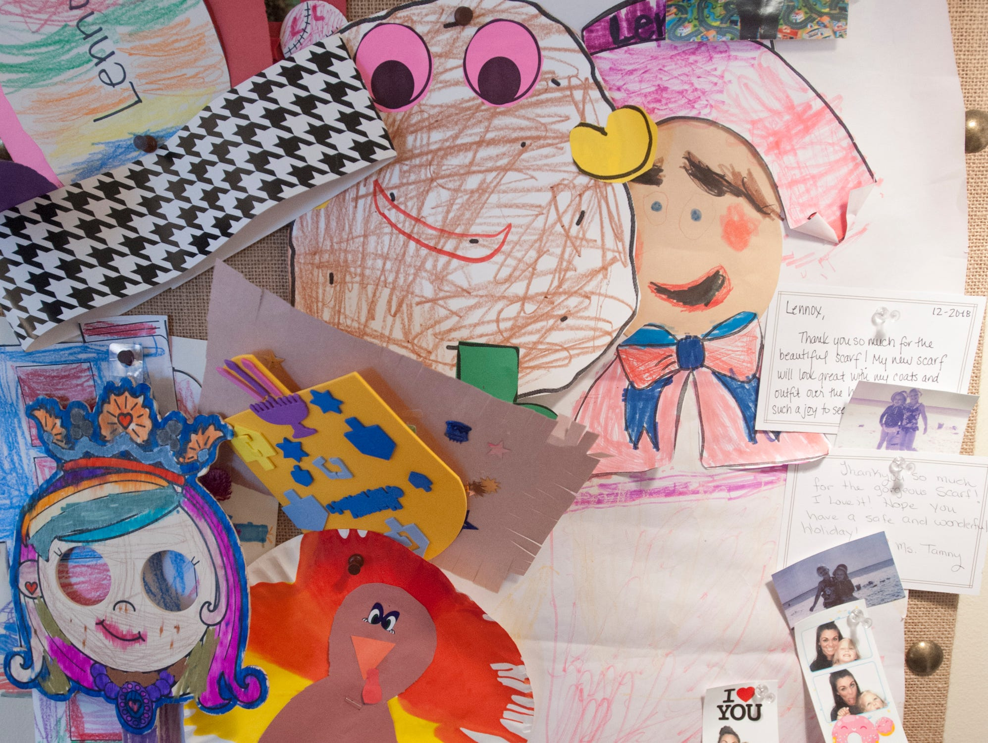 A tack board in Lennox' room is filled with completed school projects and photo booth snaps.