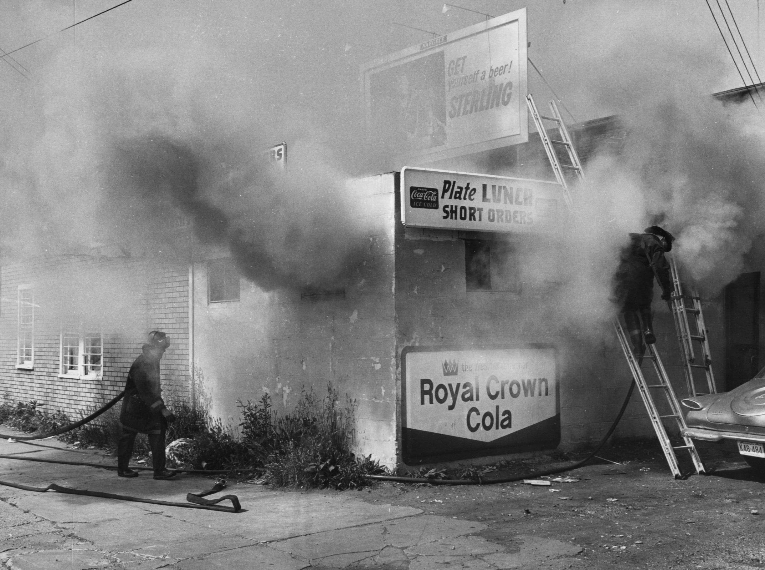 Fire that started in a wall near an exhaust fan spread to the ceiling of George's Grill at 1047 E. Main ad smoked p the area this morning.