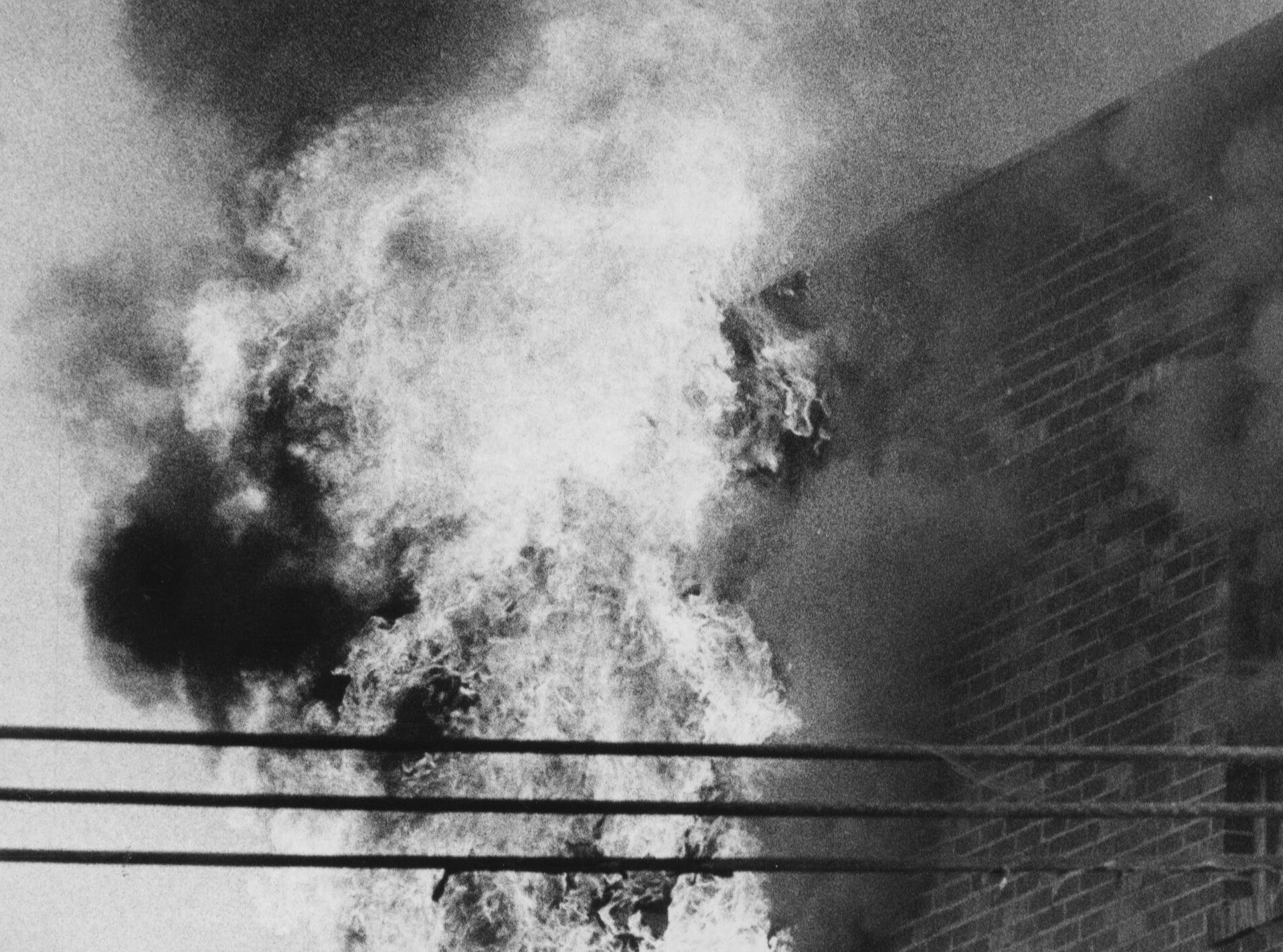 At the bottom of the stairs (far right) the firemen regroup for a second attempt.