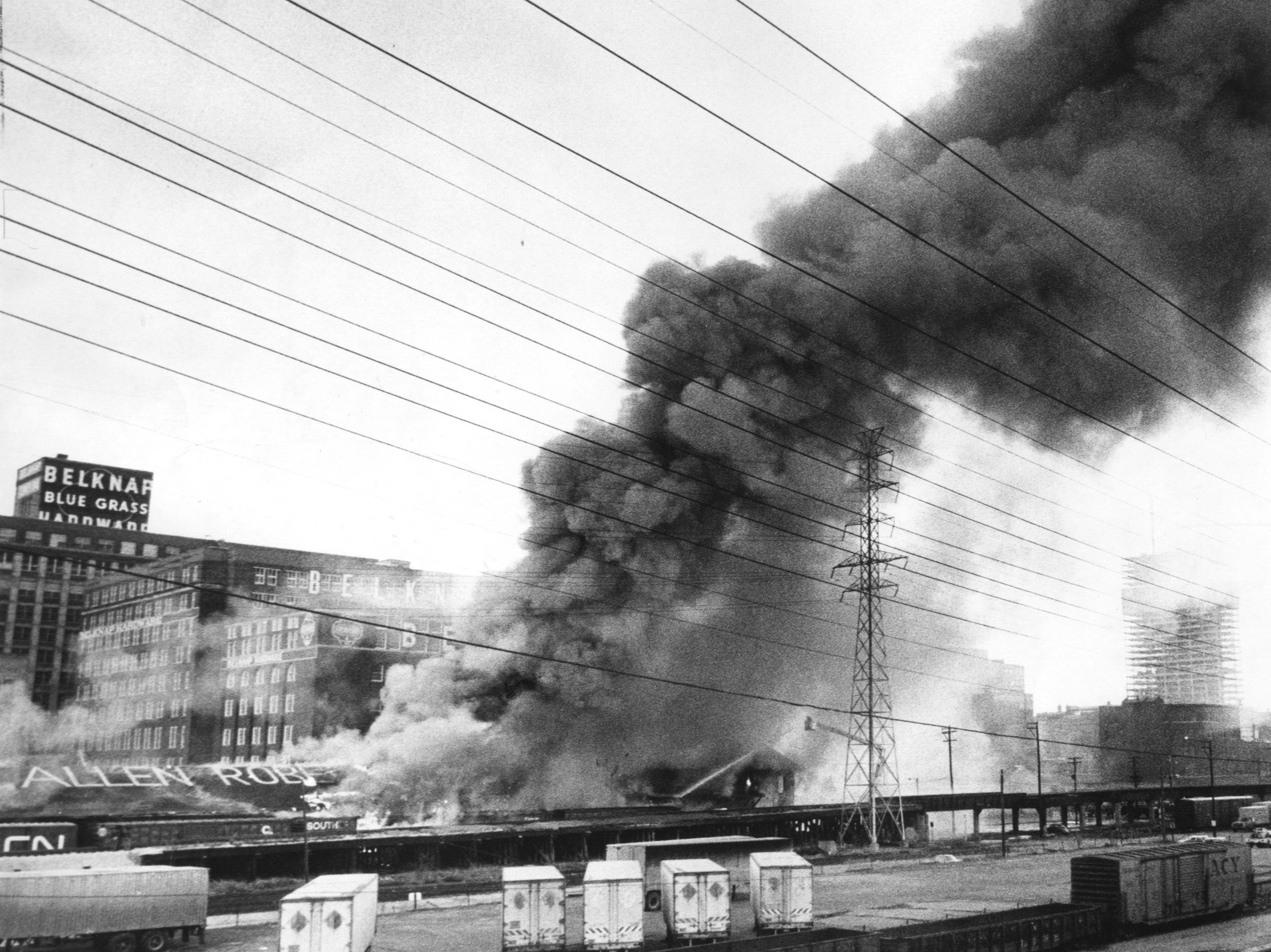 Black smoke rises from a fire in downtown Louisville yesterday that destroyed a two-story building housing Allen Robertson & Co. at 139. N. First Street. 