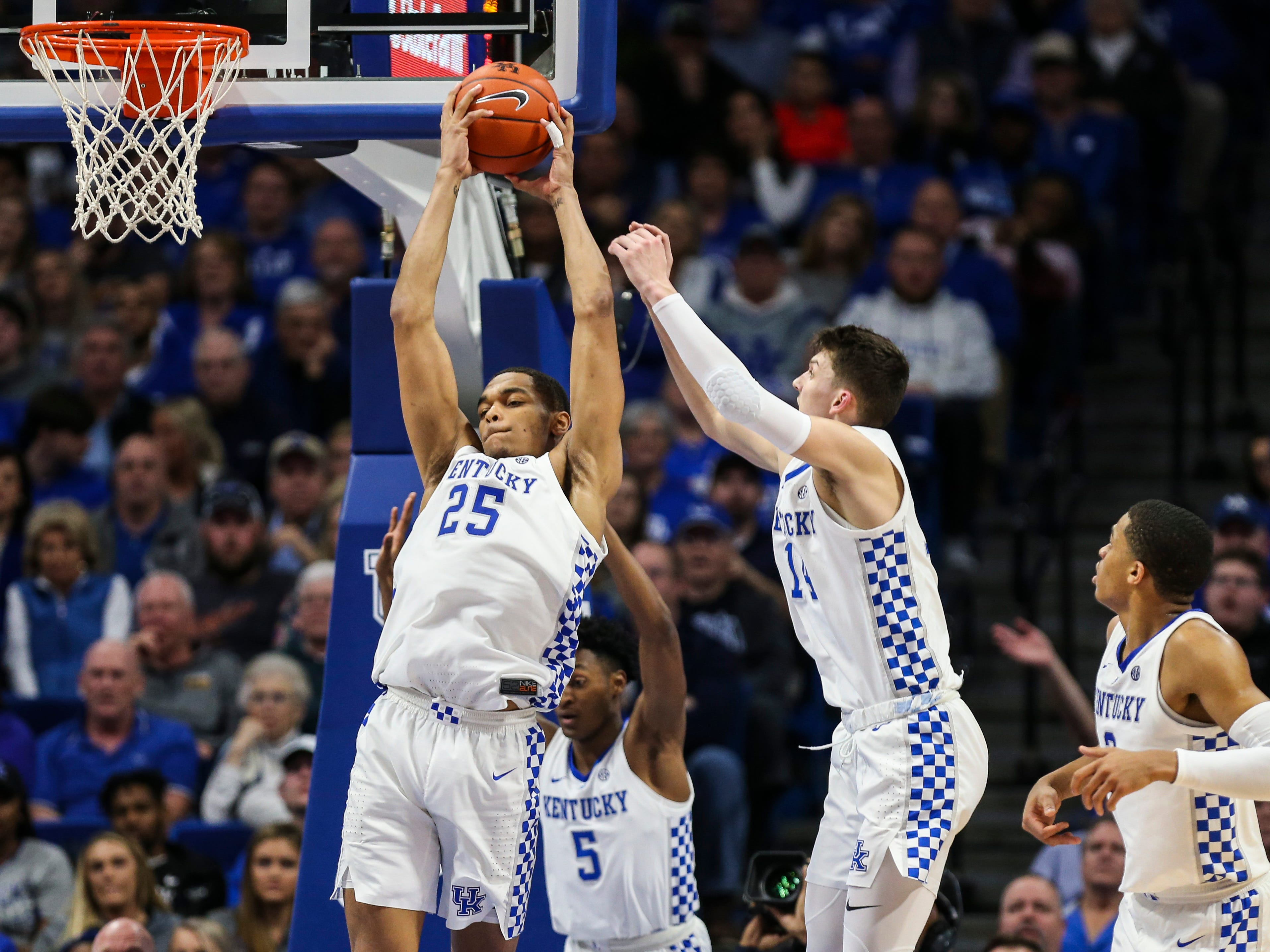Kentucky's PJ Washington grabs one of his five rebounds as the Wildcats cruised past the Gamecocks 76-48. UK had 50 rebounds to South Carolina's 27. Feb. 5, 2019