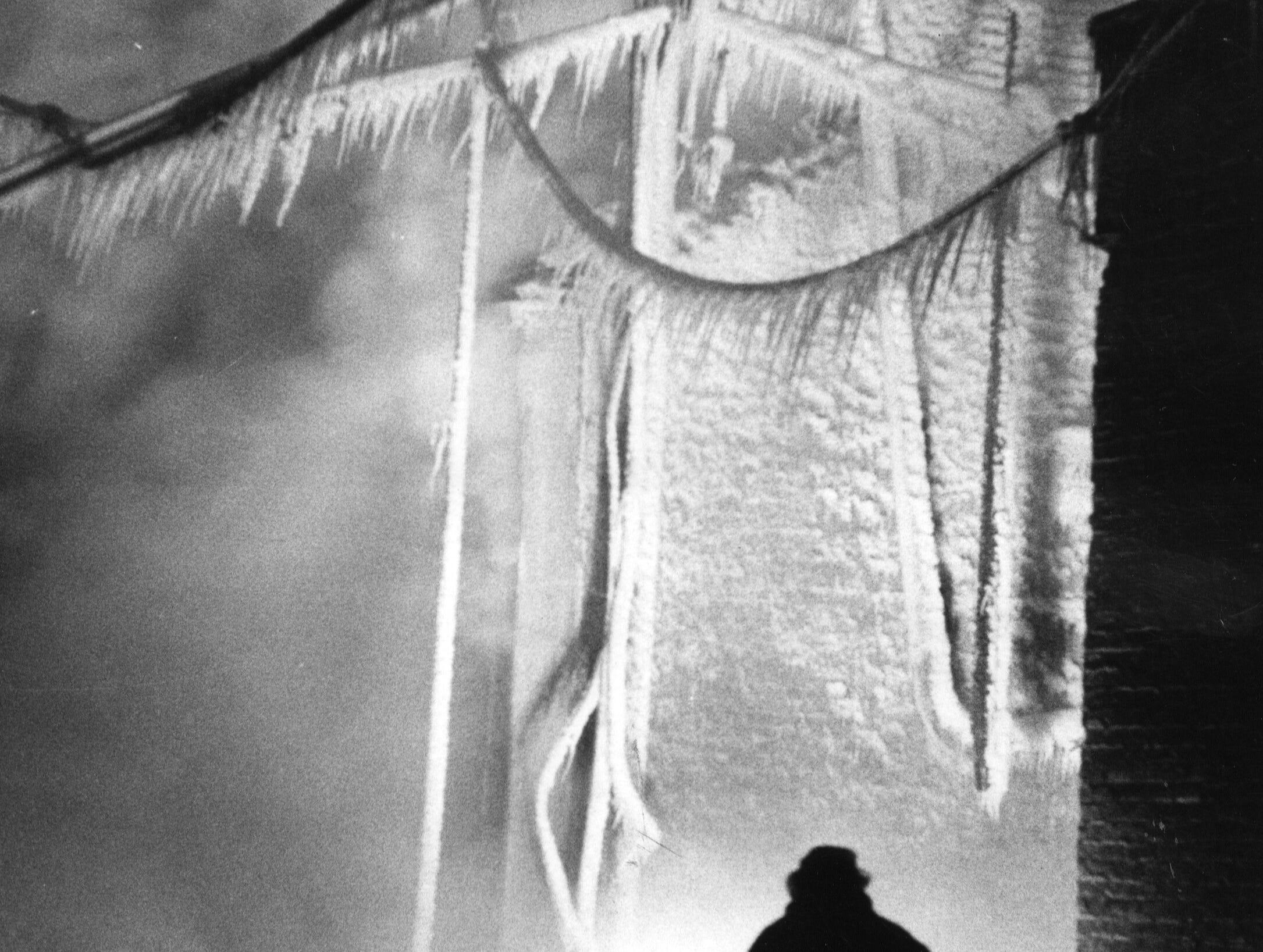 The hull or the Brinly-Handy Co. building on Preston St., near Main, is coated with ice after the fire was brought under control. 