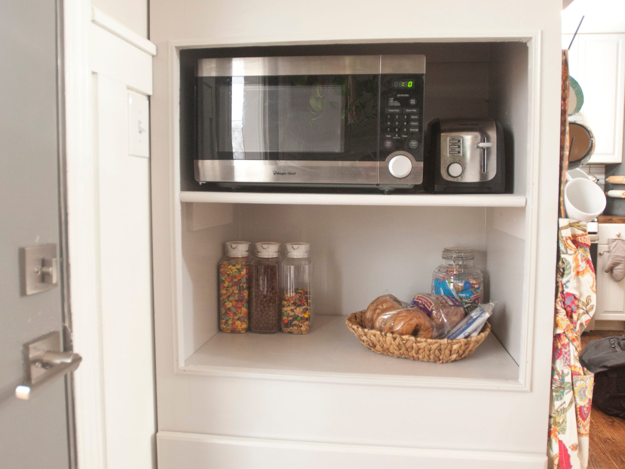 The built-in kitchen microwave cabinet provides ground to ceiling storage.