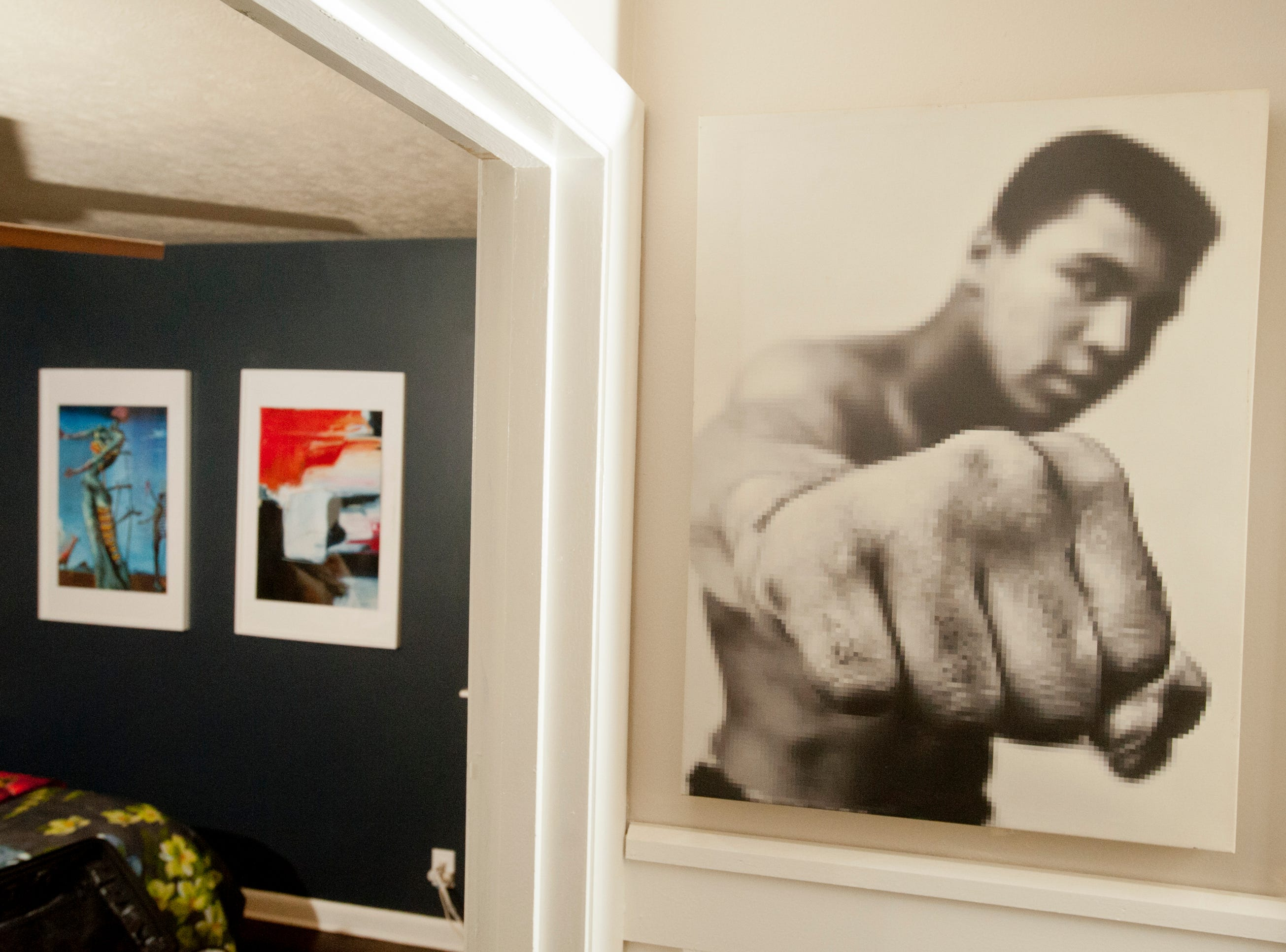 Squires' boyfriend, Zach Lorenzen, is a big Muhammad Ali fan, and a digital portrait of the champ that focuses on the boxer's fist, decorates the wall outside the master bedroom.