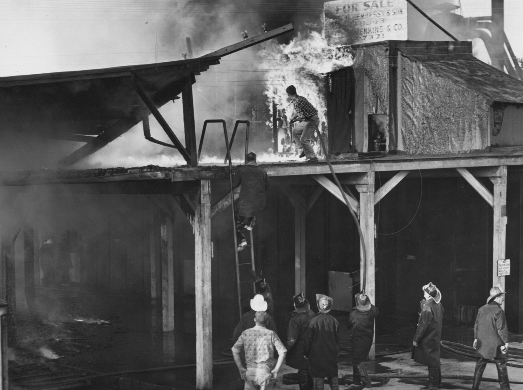 Firemen fight a fire at the National Distillers Products Corporation's old cooperage plant at 2915 North Western Parkway. 