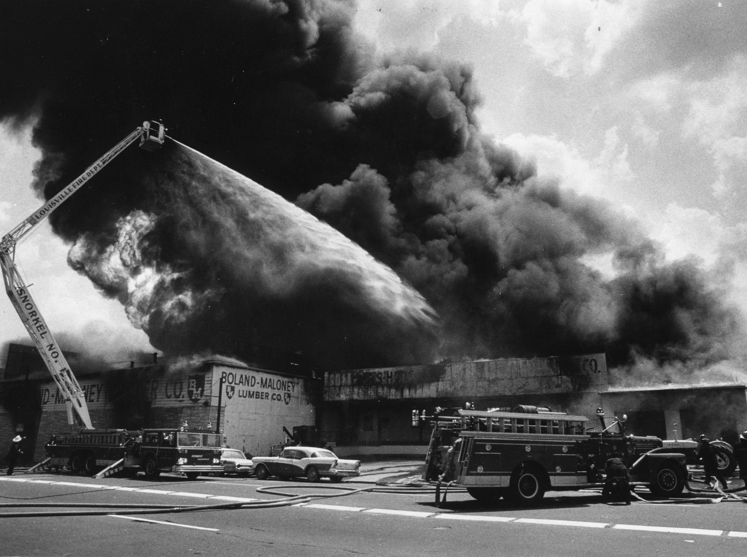 A fire at the Boland-Maloney Lumber Company.