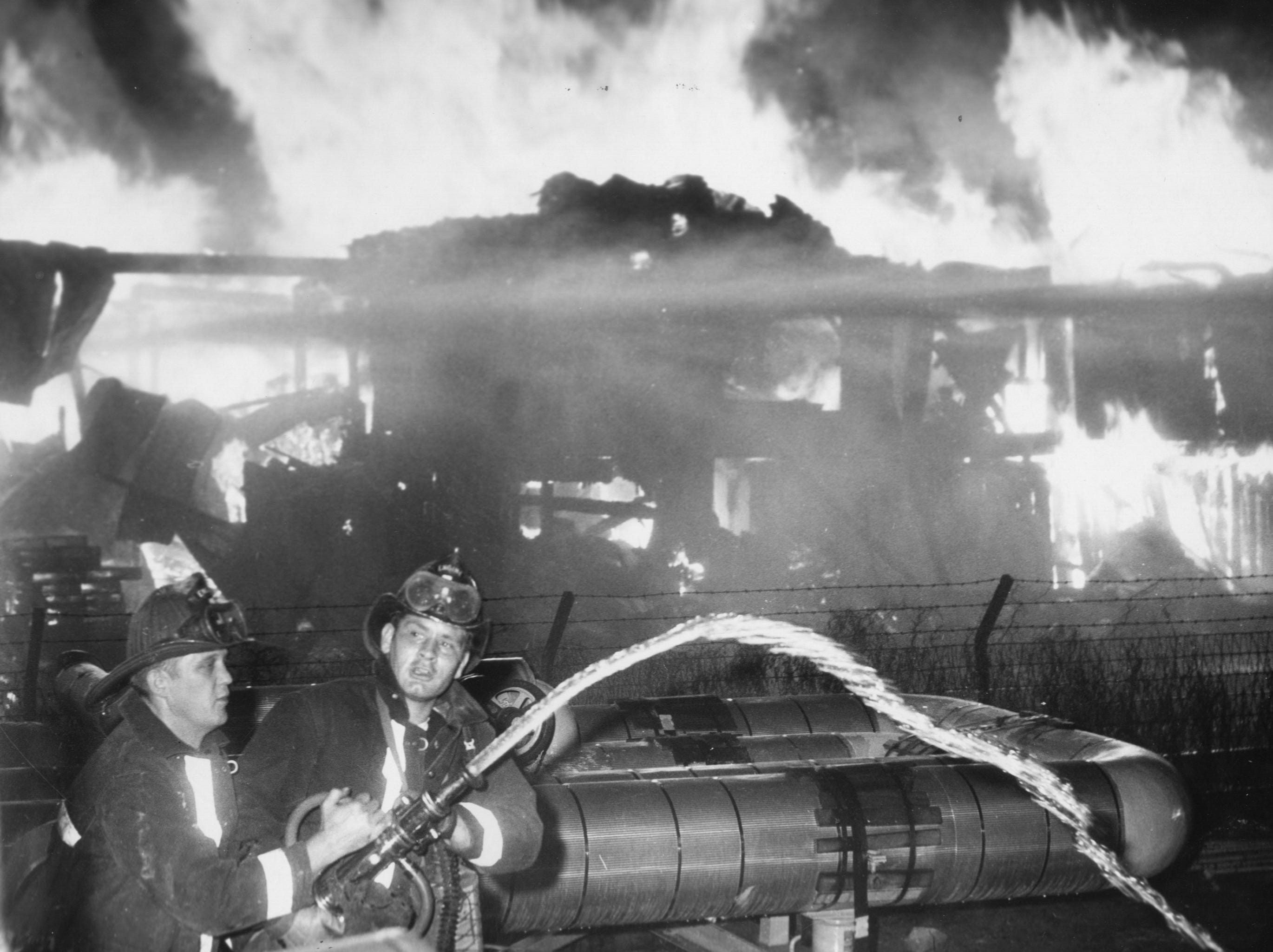 Low water pressure hampers firemen as they try to cool chemical tanks at Girdler Corp. 