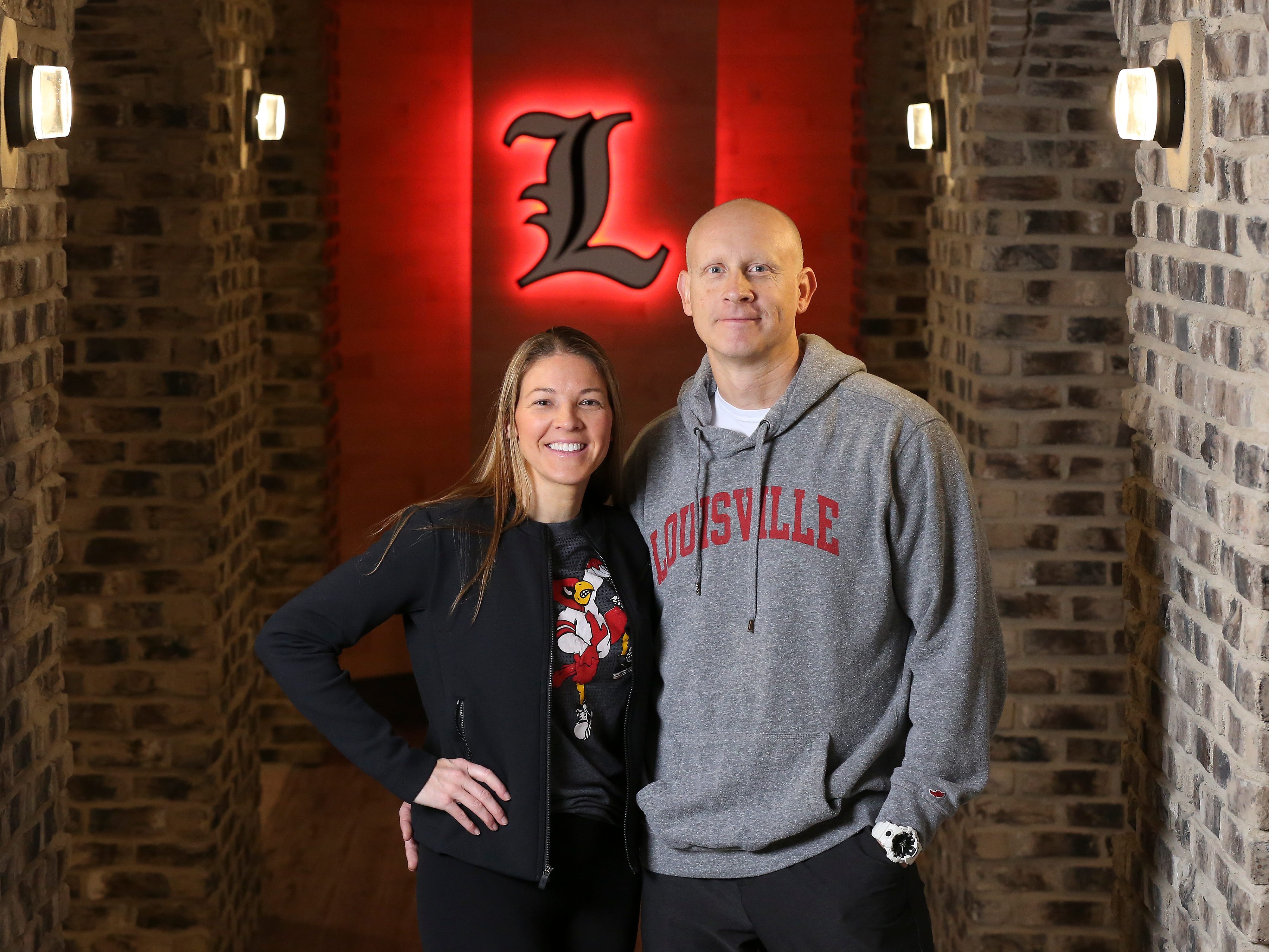 Louisville basketball coach Chris Mack, right, and his wife Christi Mack stood in the corridor leading to the entertainment area in the basement of their home.