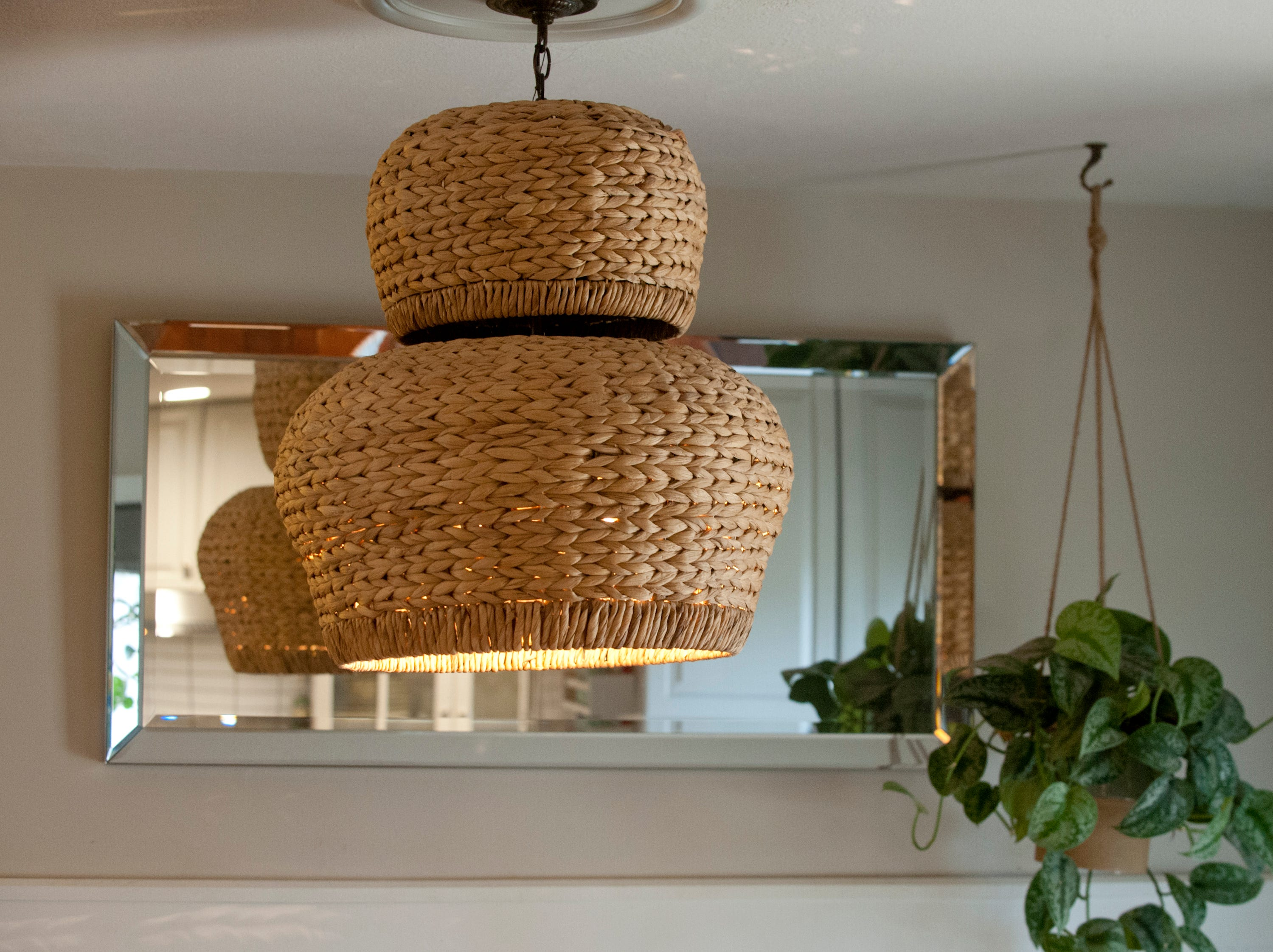 Detail of the basket light fixture above the kitchen table.