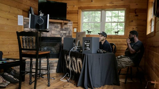 """Jecorey """"1200"""" Arthur, right, and Kojin Tashiro, left, work on recording Arthur's album during a recording retreat in a cabin at Red River Gorge."""