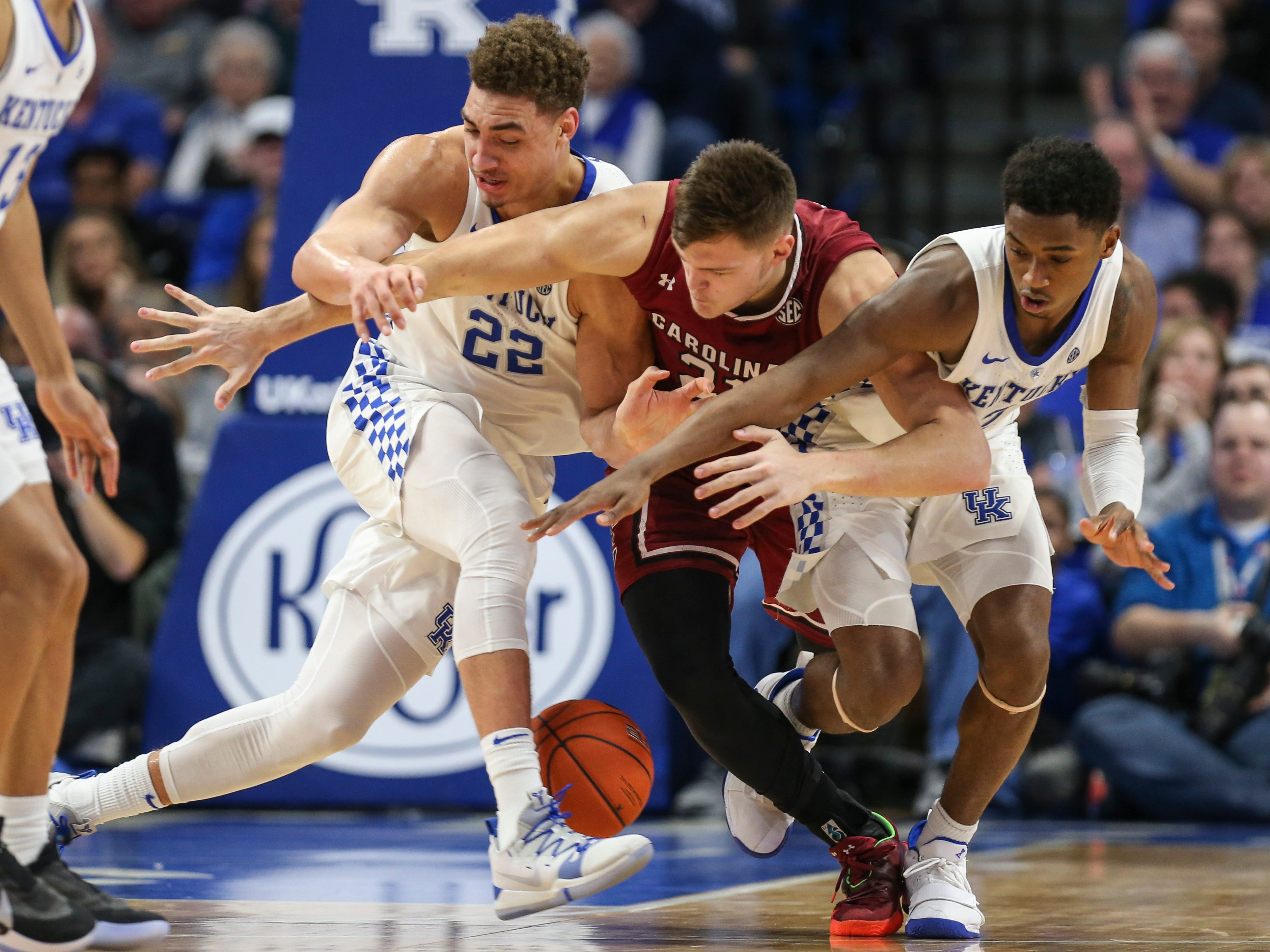 Kentucky's Reid Travis and Ashton Hagans pressured South Carolina's Maik Kotsar as the Wildcats cruised past the Gamecocks 76-48. UK had 50 rebounds to S. Carolina's 27. Feb. 5, 2019