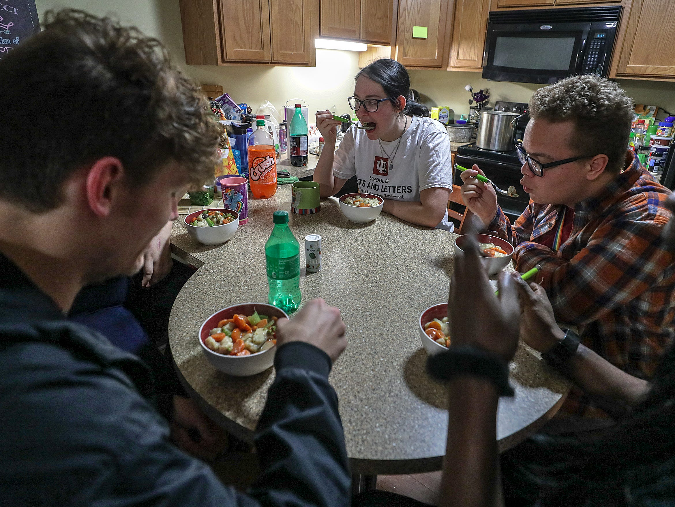 IUS students Brianna Reynolds, Johnie Adams, Stephon Camp, Josiah Pohl and Jeanette Hansen eat together in their campus housing with some of the food they received from the campus food bank. Feb. 5, 2019