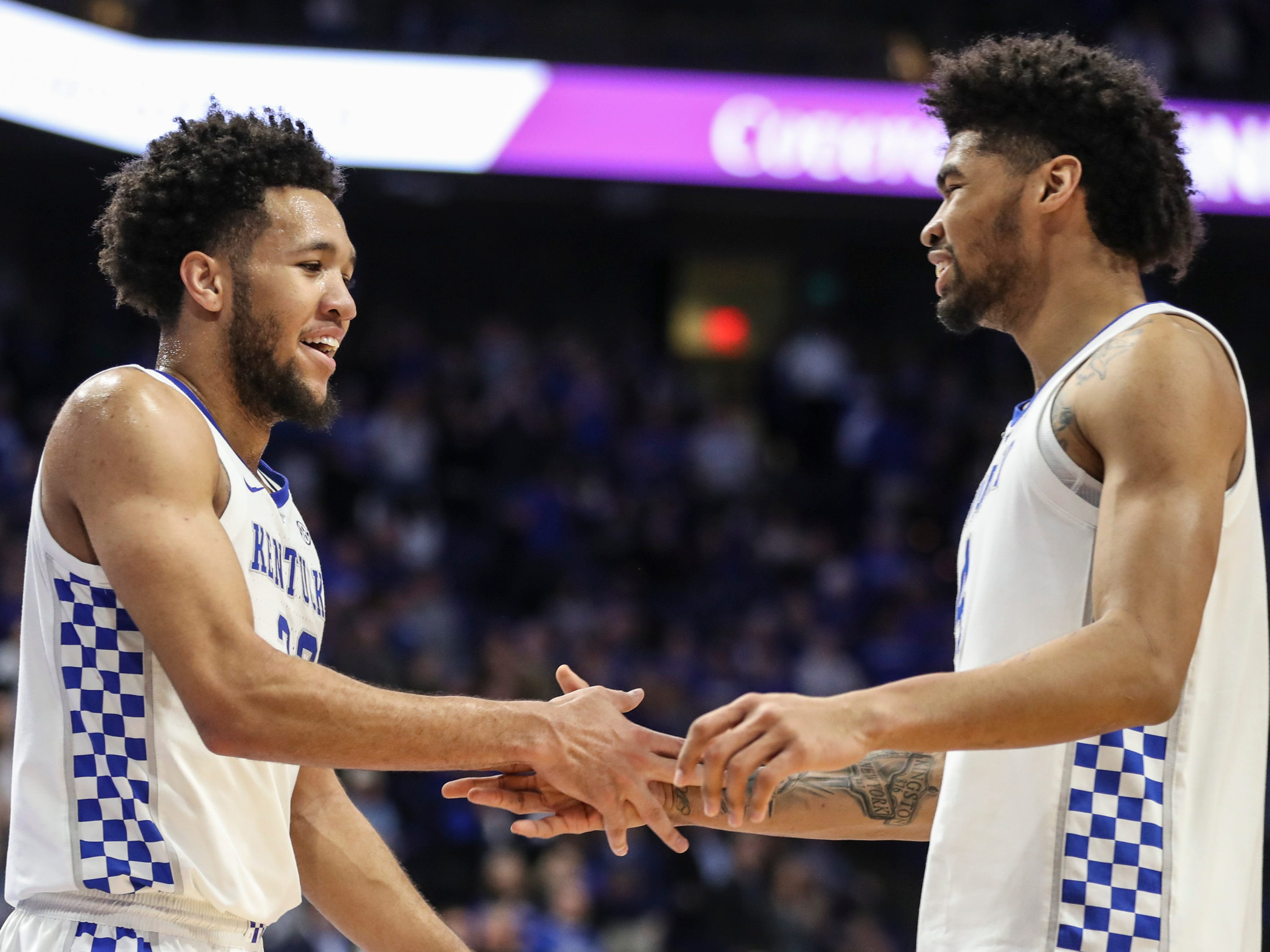 'Ej was really, really good,' said UK coach John Calipari after the Wildcats beat South Carolina. 'Double-double, active, playing hard, blocking shots. He's starting to come around. This was a great game for him to prove it against a really physical team.' EJ Montgomery, left, gets congratulated by teammate Nick Richards at the end of the South Carolina game. Feb. 5, 2019