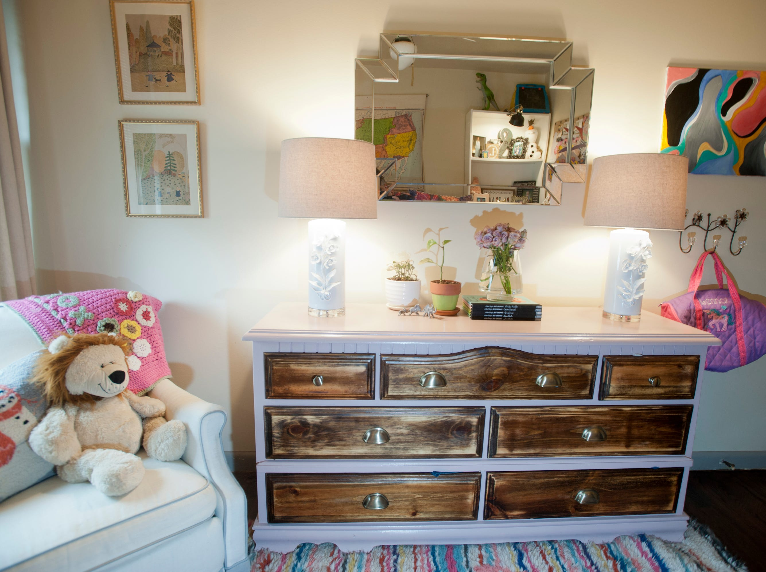 A vintage mid-century chest of drawers in Lennox' bedroom was purchased from an auction site.