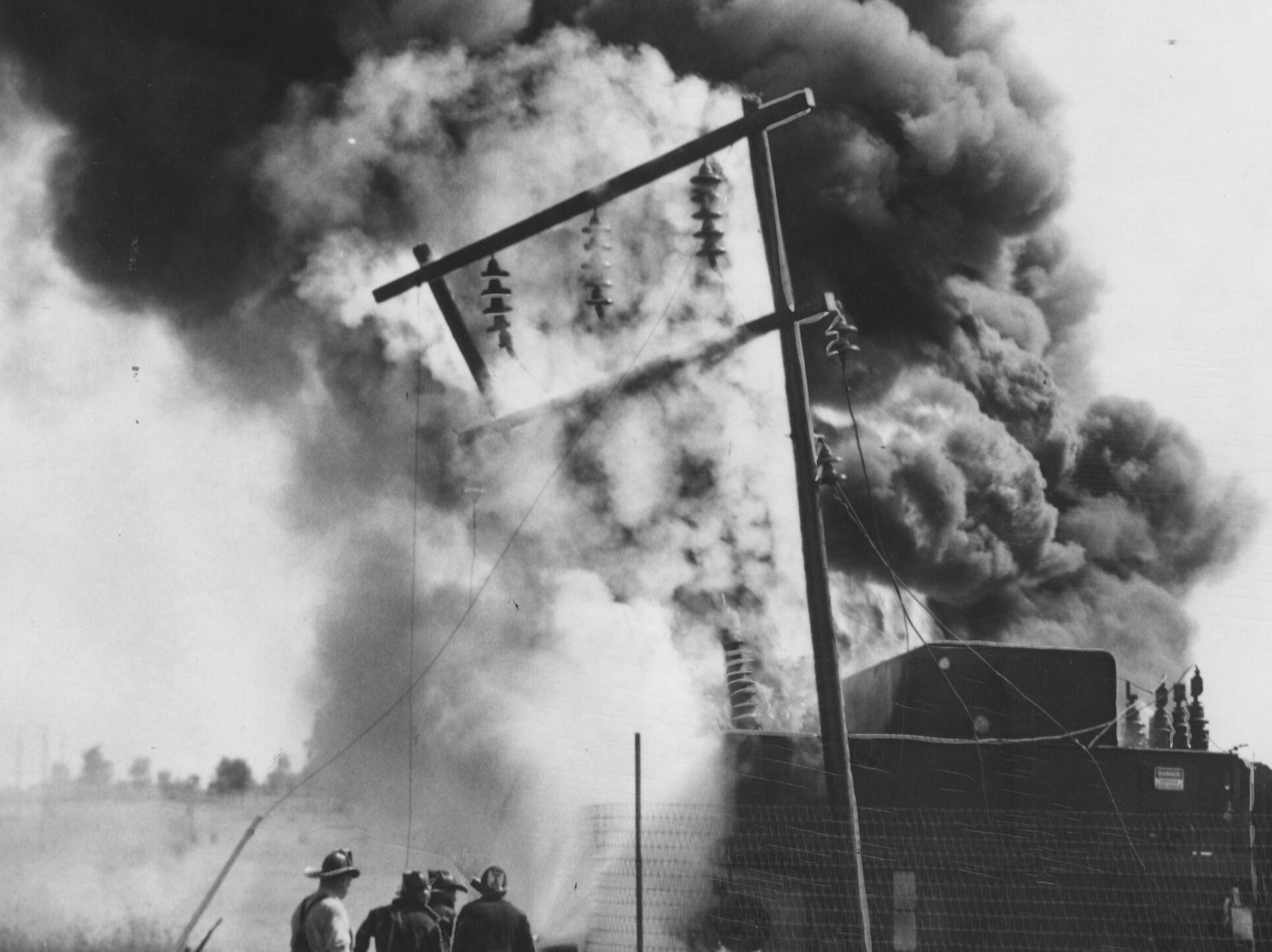 Greasy black smoke billows from an L. G. & E. transformer which burned at station WHAS today. 