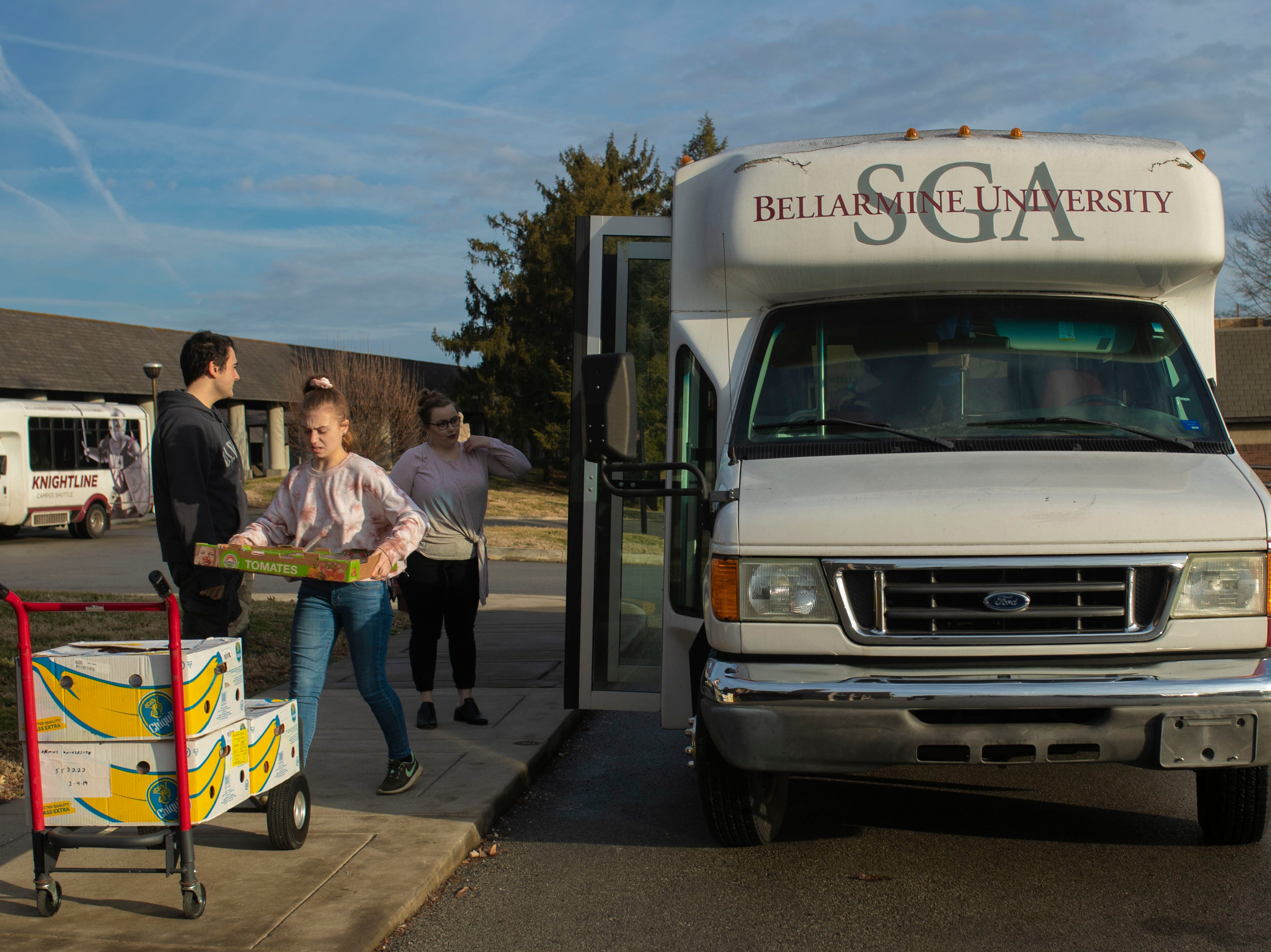 Bellarmine students unload food items picked up at the Dare to Care food bank to be added to the university's food pantry. The food pantry at Bellarmine is open to any students who may benefit from access to extra snacks and meals. Feb. 4, 2019