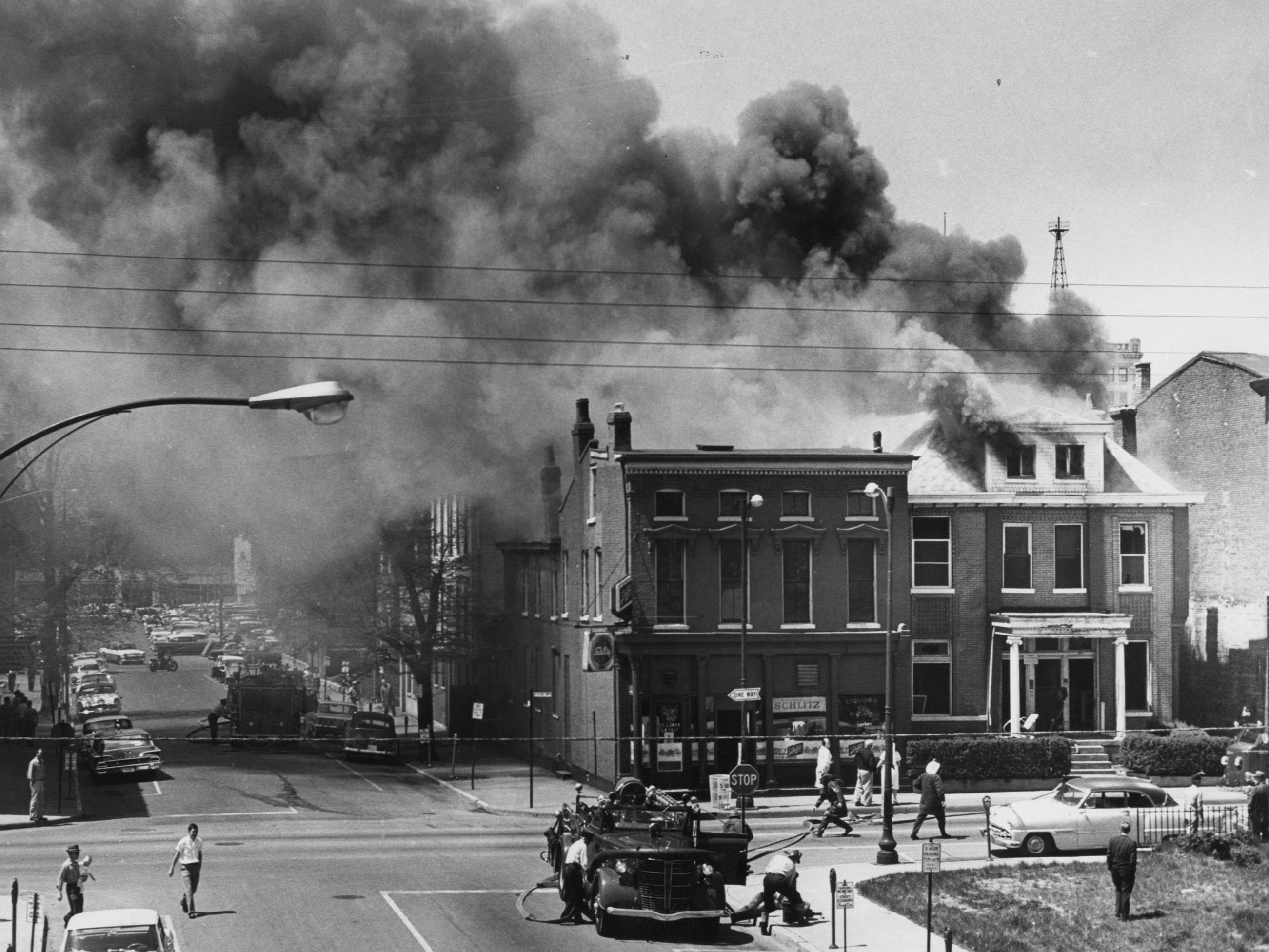 Firemen battled for over 2 hours yesterday before quelling two separate fires involving four buildings in the 600 block of South First near Gray. 