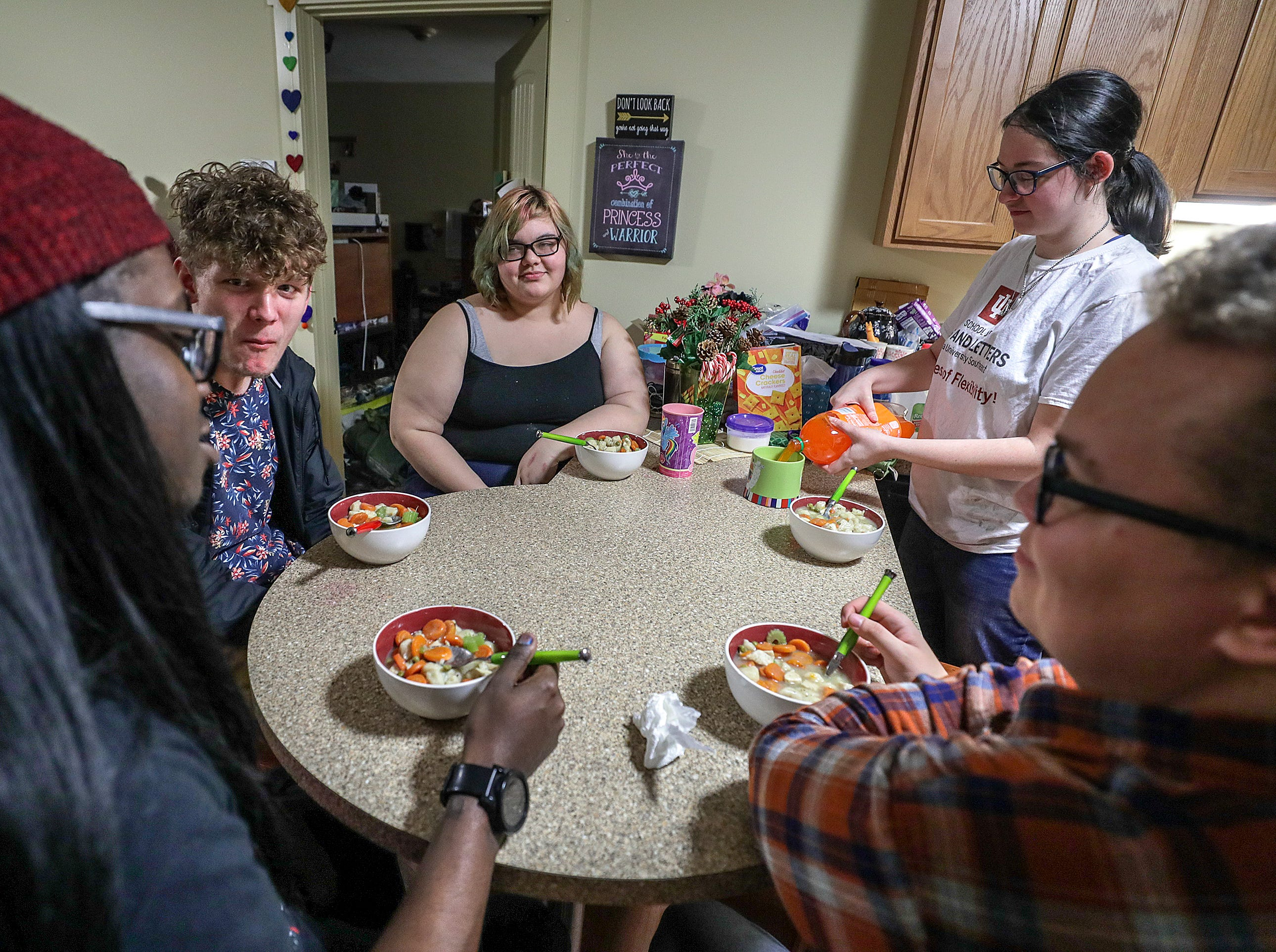 IUS students Brianna Reynolds, Johnie Adams, Stephon Camp, Josiah Pohl, and Jeanette Hansen eat together in their campus housing with some of the food the received from the campus food bank.February 5, 2019