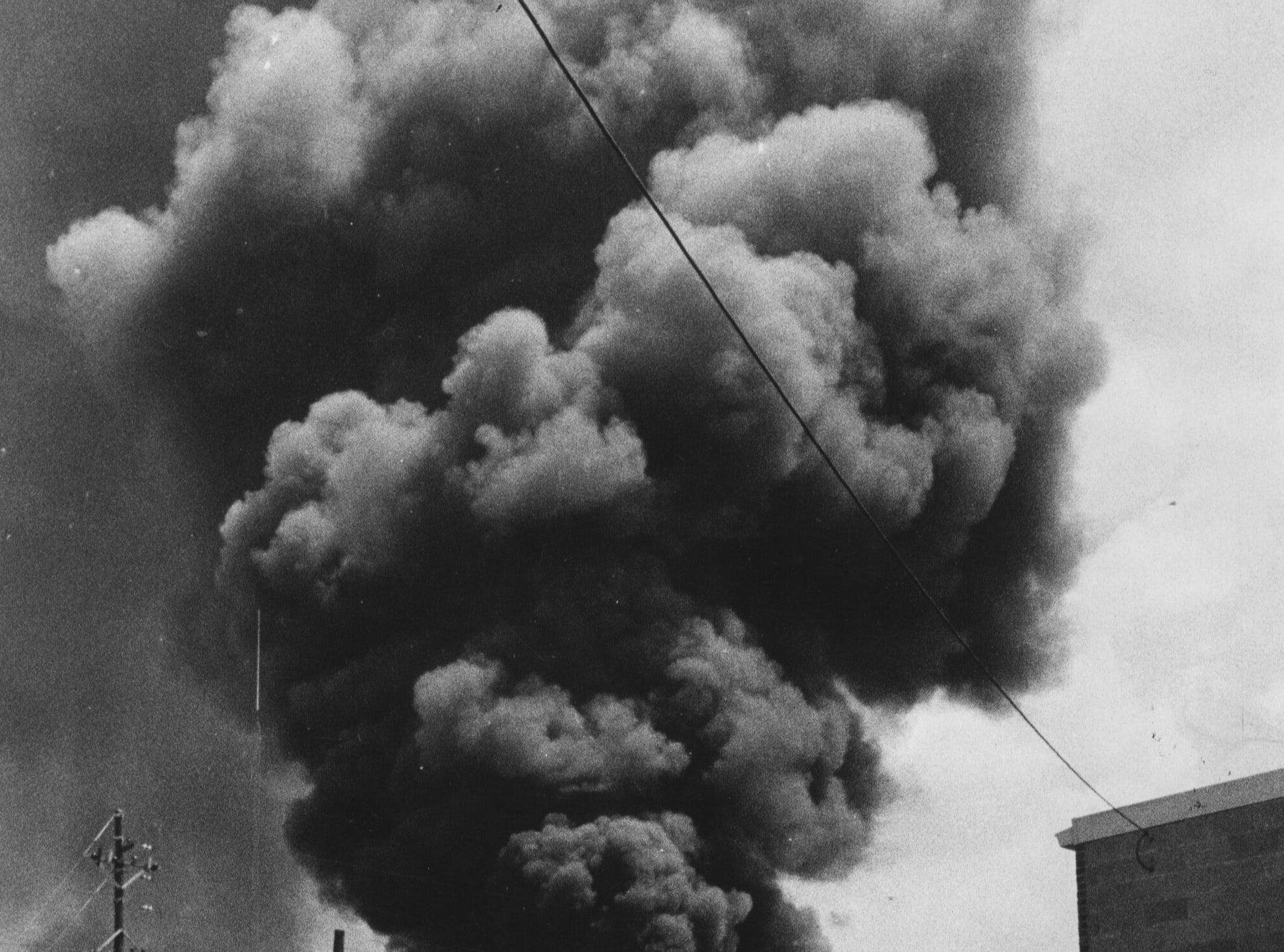 Black smoke towers over Louisville as the Boland-Maloney Lumber Co. was destroyed by fire yesterday. 