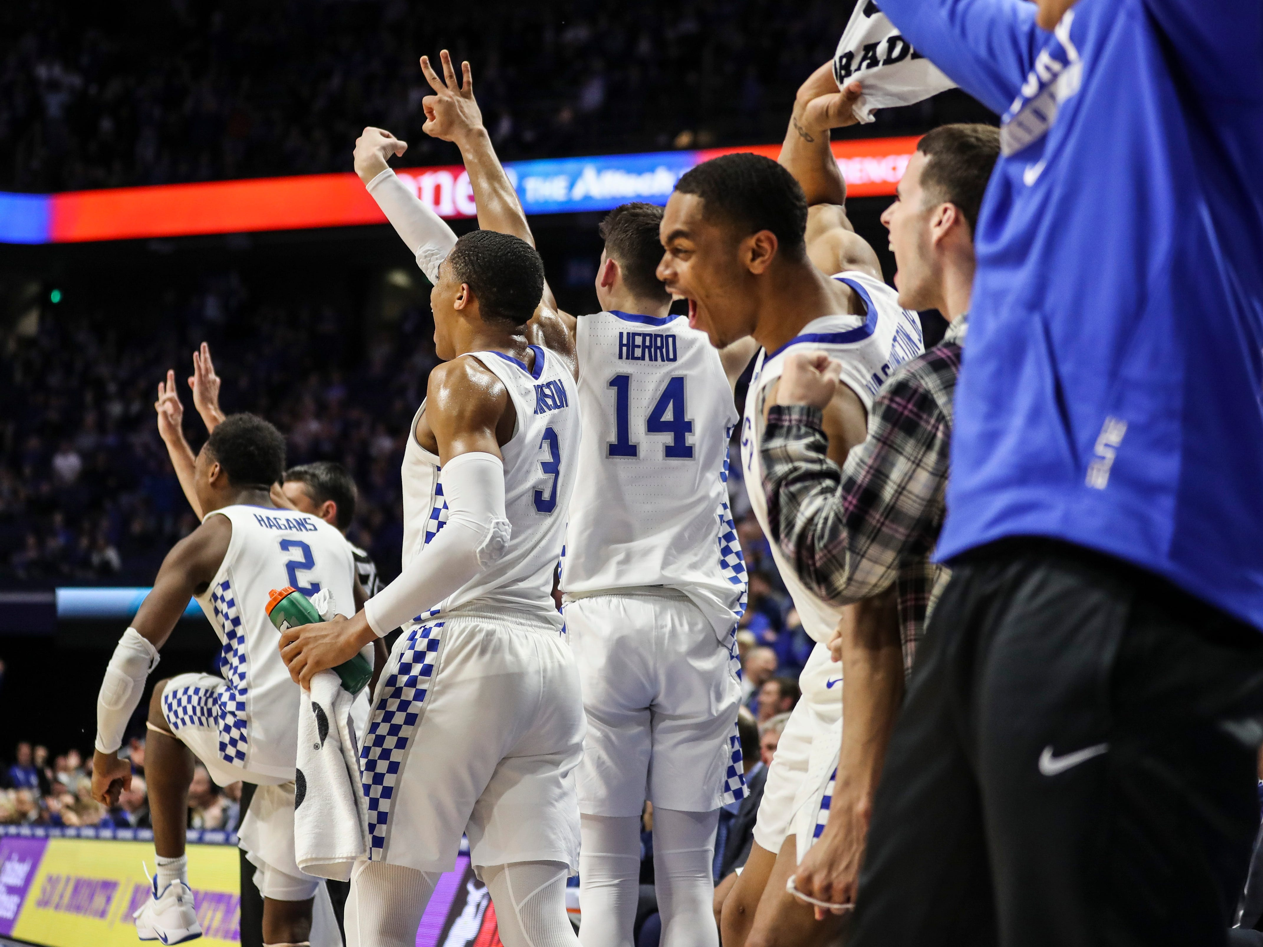Kentucky's PJ Washington Jr celebrates from the sidelines late in the second half as the Wildcats cruised past South Carolina 76-48. Washington had 20 points and was 2-for-4 for three-point shots. Feb. 5, 2019