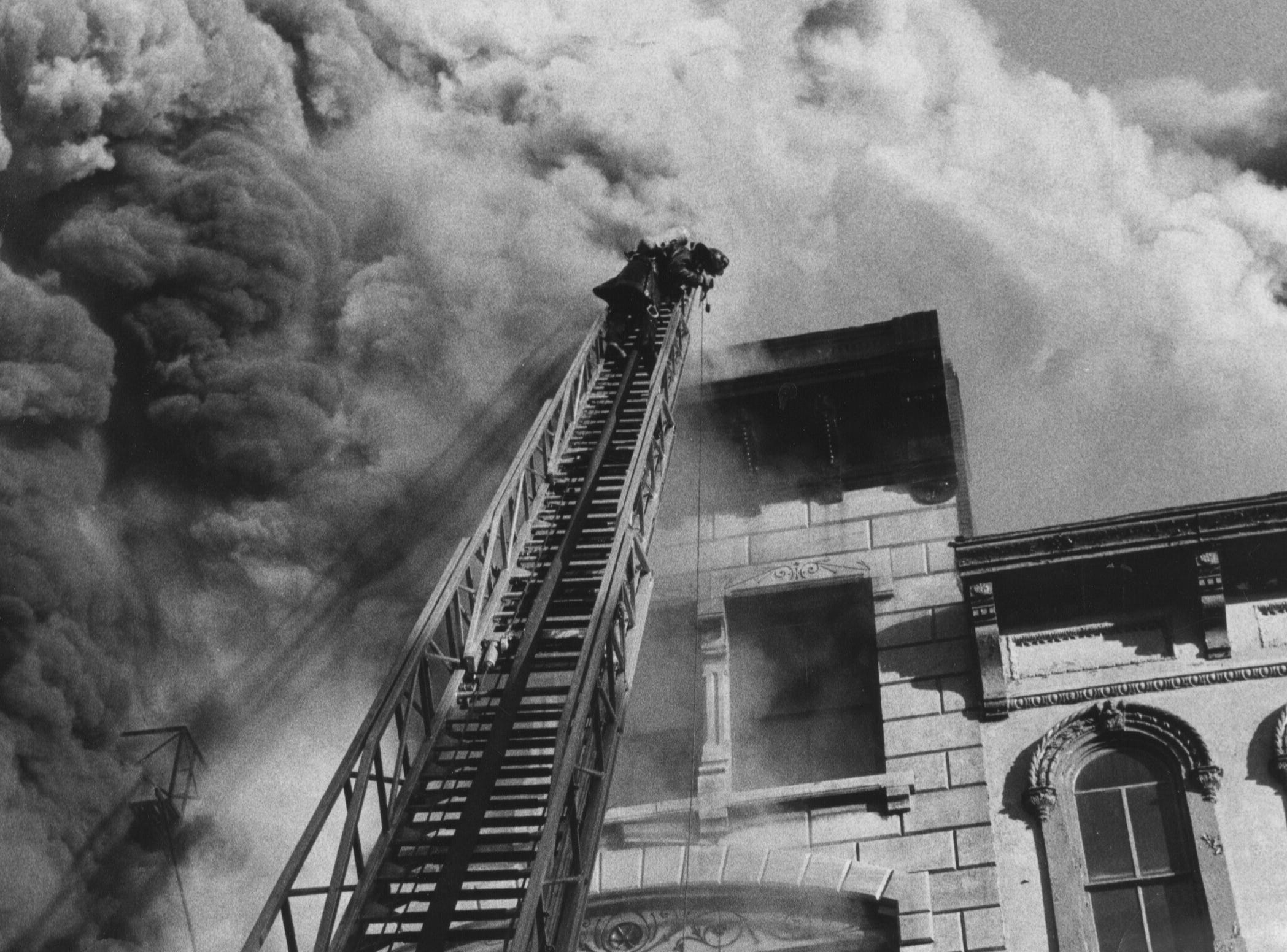 Firemen answered a three-alarm call this morning to stop a fire in the 600 block of W. Main Street which left at least one person dead and several injured. 