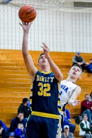DeWitt's Mason Gilbert shoots in front of Ionia's Nick Szymanski during the second quarter on Tuesday, Feb. 5, 2019, at Ionia High School.