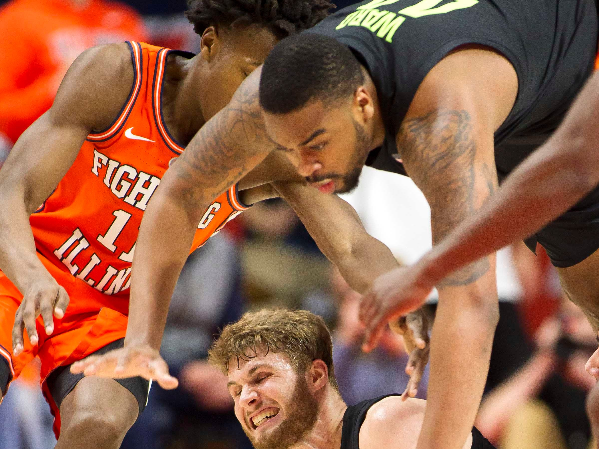 Feb 5, 2019; Champaign, IL, USA; Michigan State Spartans forward Kyle Ahrens (0) grabs a loose ball during the second half against the Illinois Fighting Illini at State Farm Center. Mandatory Credit: Mike Granse-USA TODAY Sports