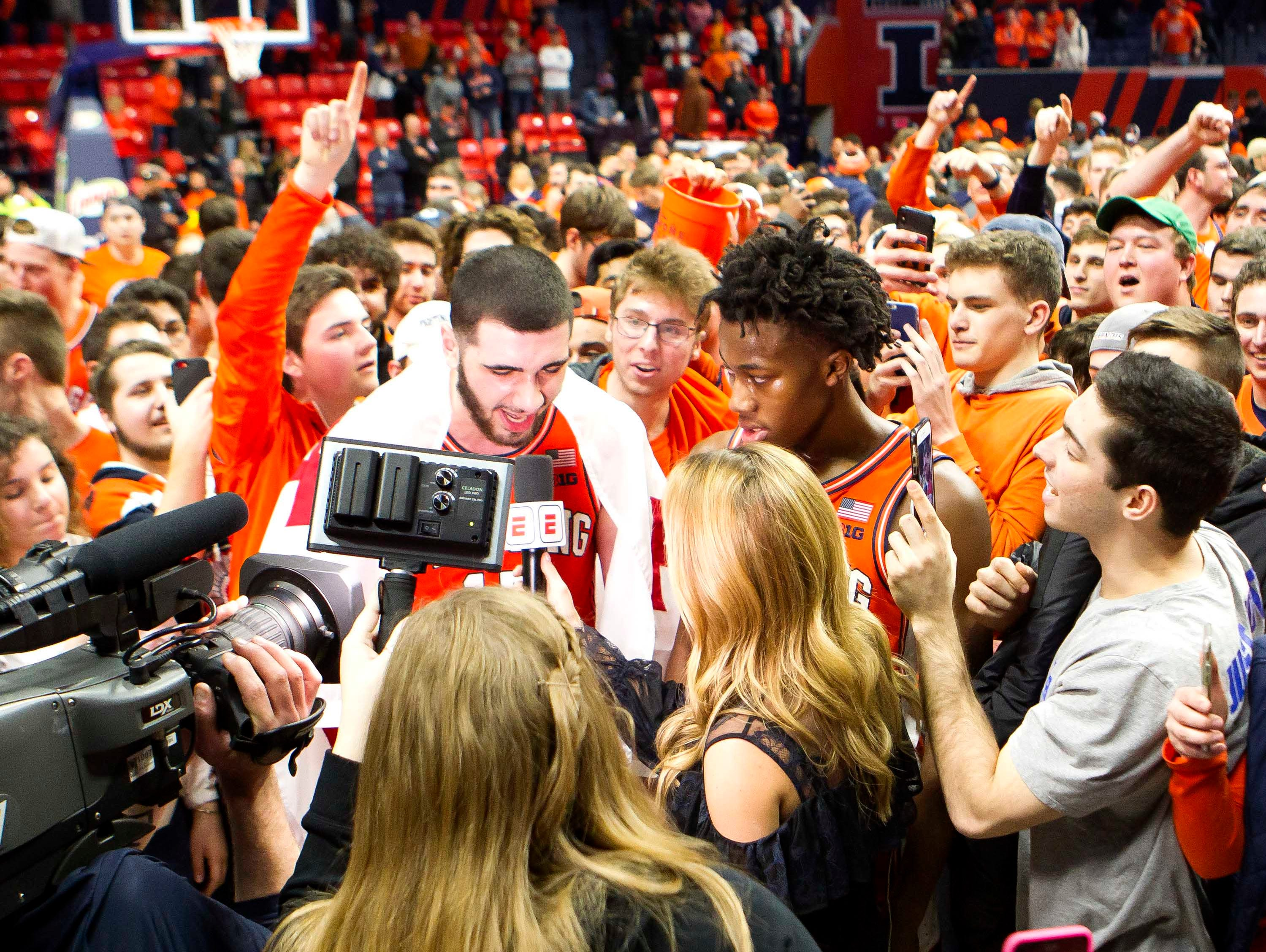 Feb 5, 2019; Champaign, IL, USA; Illinois Fighting Illini forward Giorgi Bezhanishvili (15) and guard Ayo Dosunmu (11) are interviwed after the game against the Michigan State Spartans at State Farm Center. Mandatory Credit: Mike Granse-USA TODAY Sports