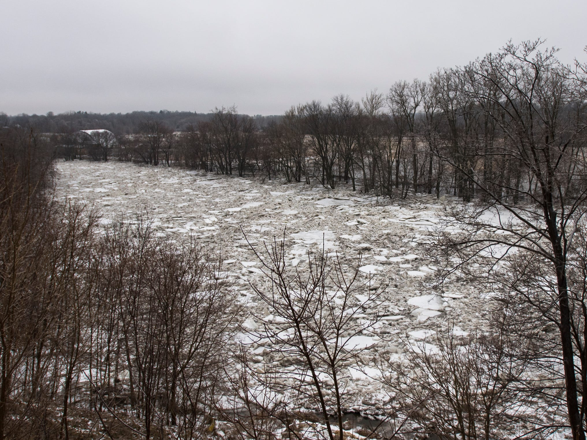 A view of the Grand River where ice jams have occurred  Portland, Michigan, Wednesday morning, Feb. 6, 2019.  About 50 people were evacuated late Tuesday evening through early Wednesday morning due to flooding along the Grand River caused by melting snow and an ice jam in the river.  [Matthew Dae Smith/Lansing State Journal]
