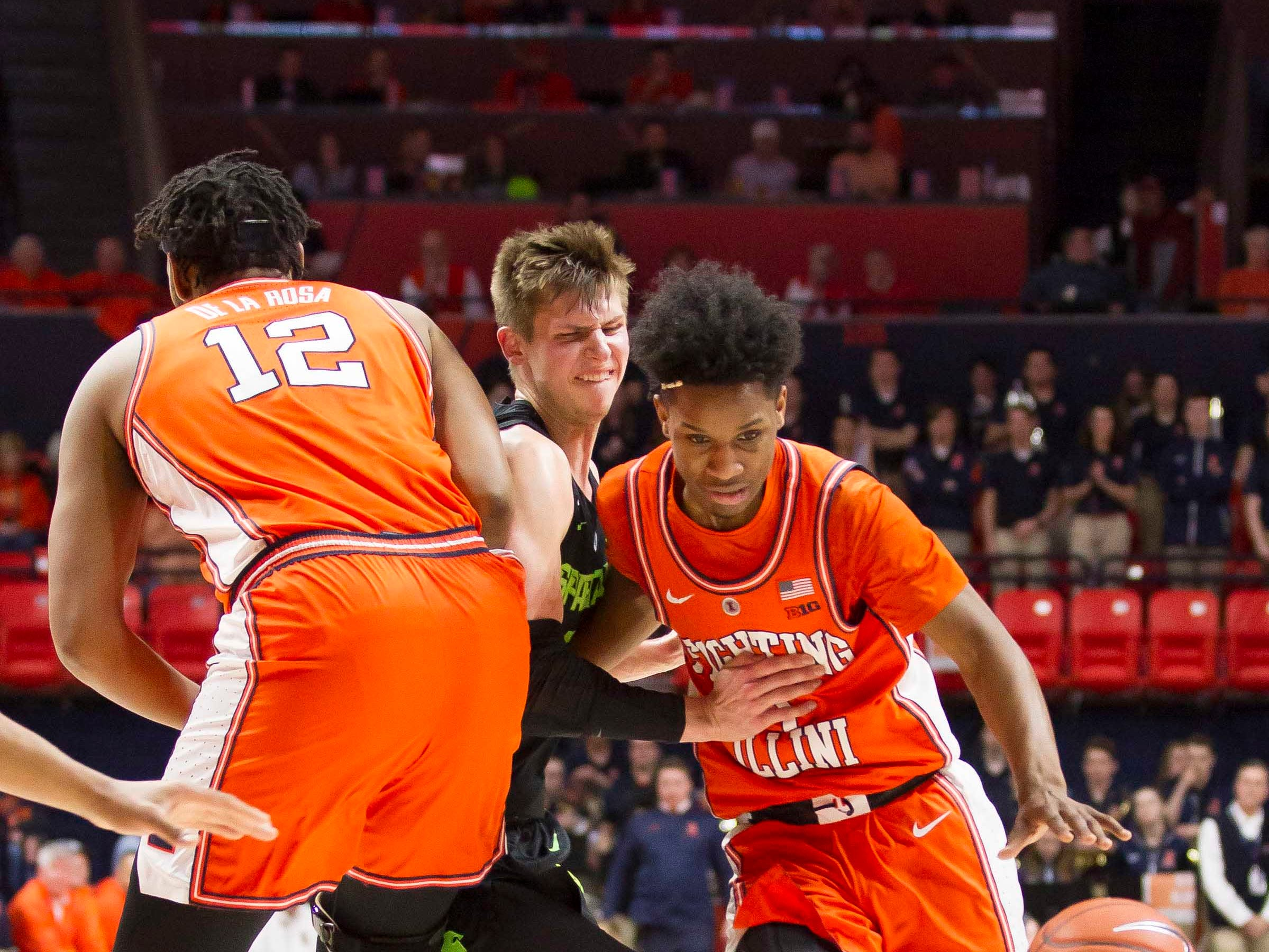 Feb 5, 2019; Champaign, IL, USA; Illinois Fighting Illini center Adonis De La Rosa (12) sets a pick on Michigan State Spartans guard Matt McQuaid (20) asIllinois Fighting Illini guard Trent Frazier (1) drives to the basket during the first half at State Farm Center. Mandatory Credit: Mike Granse-USA TODAY Sports