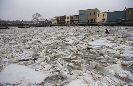 This photo shows downtown Portland along the Grand River on Feb. 6, 2019. About 50 people were evacuated beginning the night before due to flooding caused by melting snow and an ice jam in the river. [Matthew Dae Smith/Lansing State Journal]