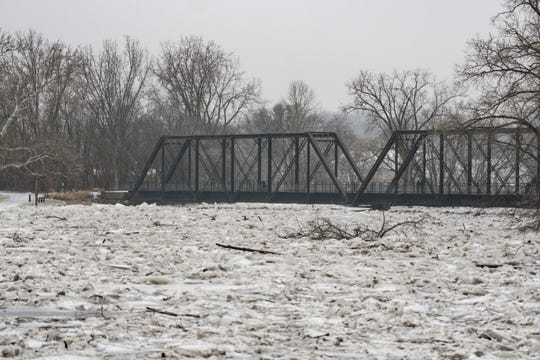 Downtown Portland along the Grand River, \Wednesday morning, Feb. 6, 2019.  About 50 people were evacuated late Tuesday evening through early Wednesday morning due to flooding along the Grand River caused by melting snow and an ice jam in the river.  [Matthew Dae Smith/Lansing State Journal]