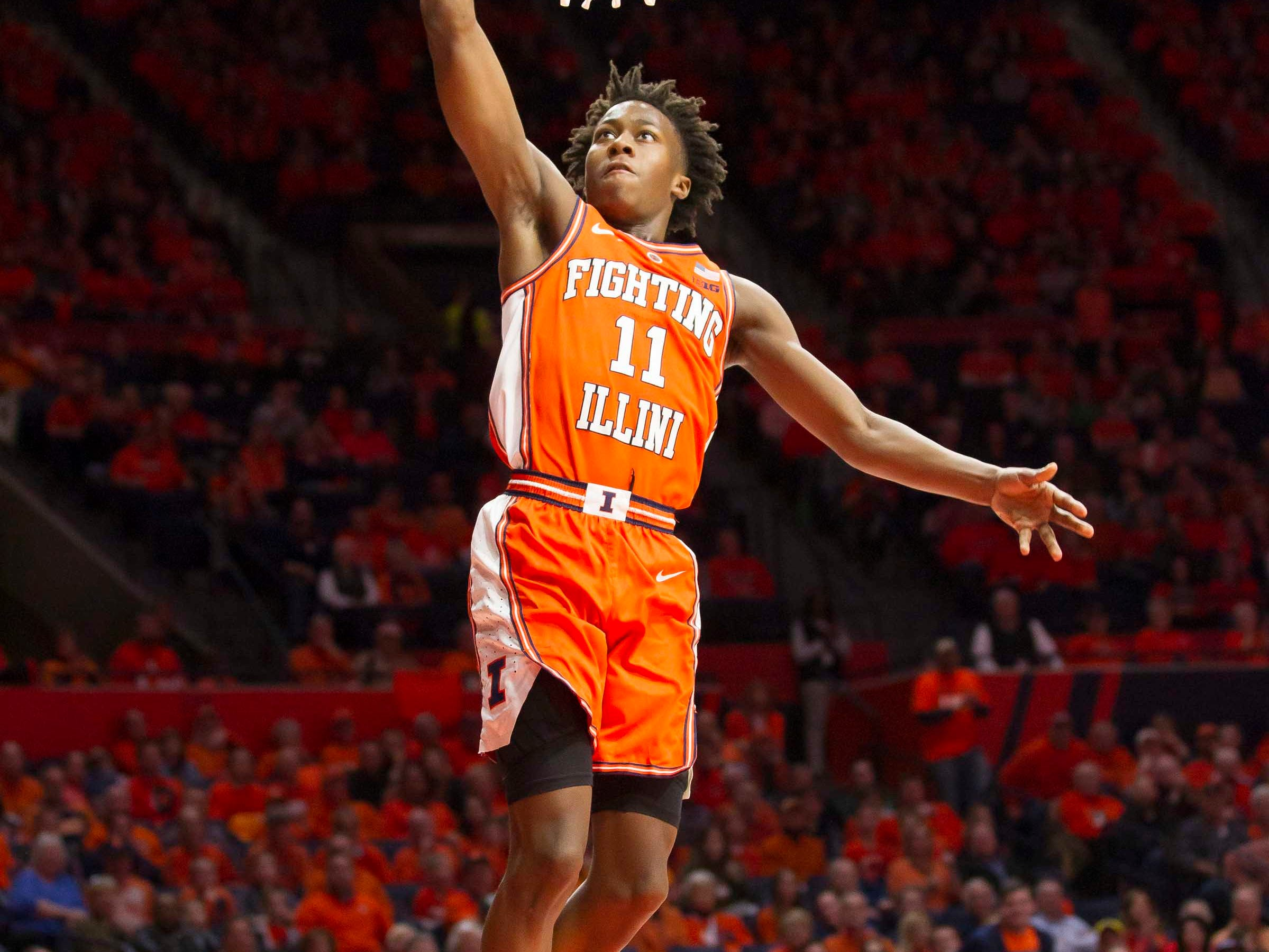 Feb 5, 2019; Champaign, IL, USA; Illinois Fighting Illini guard Ayo Dosunmu (11) dunks the ball during the first half against the Michigan State Spartans at State Farm Center. Mandatory Credit: Mike Granse-USA TODAY Sports