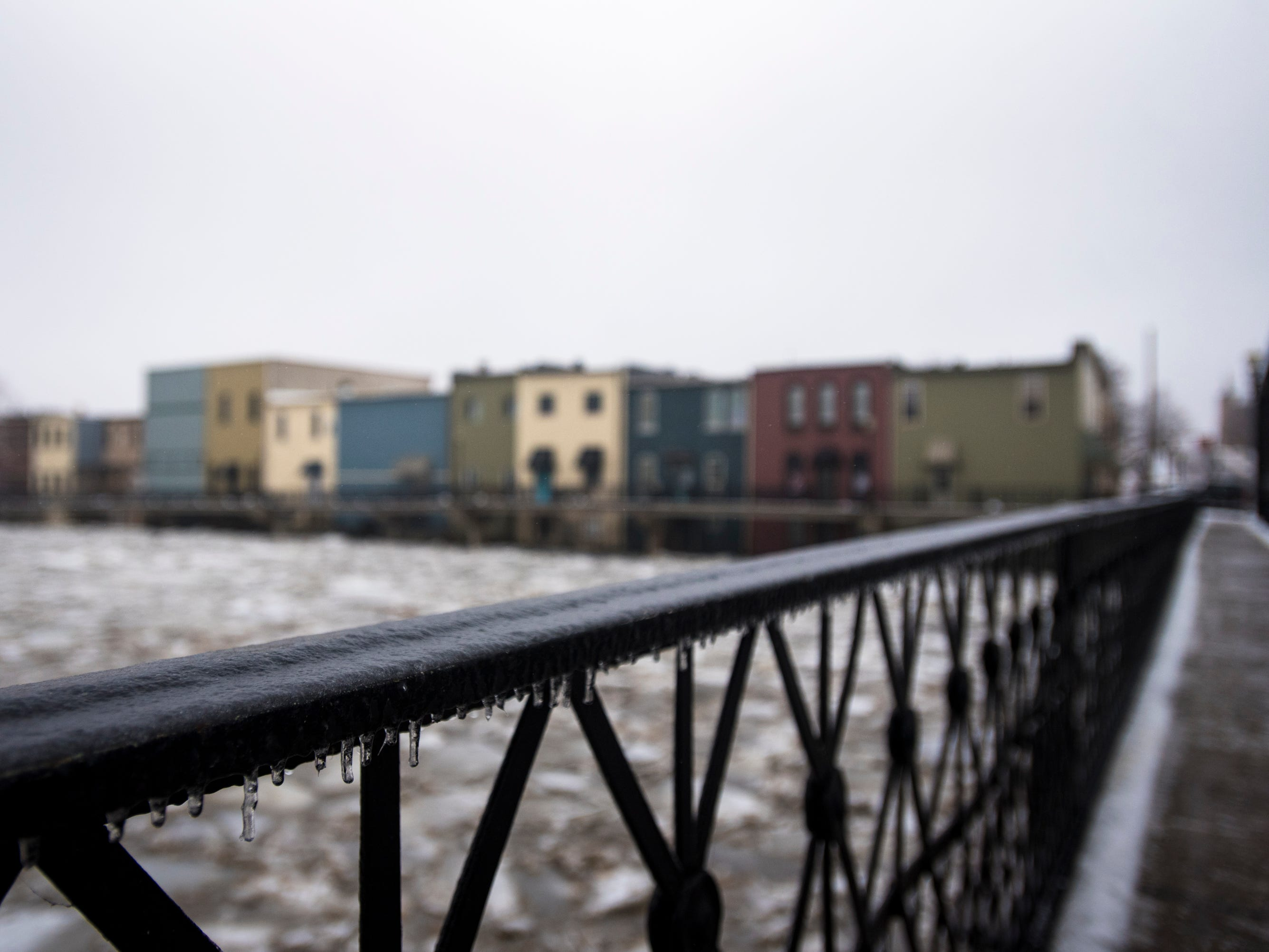 Downtown Portland, Michigan and the Grand River, Wednesday morning, Feb. 6, 2019.  About 50 people were evacuated late Tuesday evening through early Wednesday morning due to flooding along the Grand River caused by melting snow and an ice jam in the river.  [Matthew Dae Smith/Lansing State Journal]