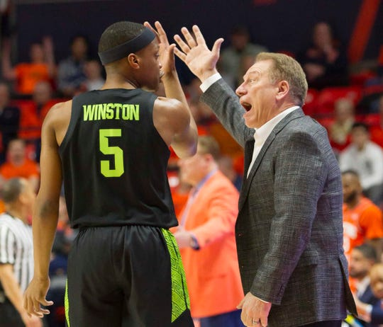Michigan State coach Tom Izzo and MSU point guard Cassius Winston debate what just happened during first-half action Tuesday night at Illinois. Winston turned the ball over 7 times before halftime.
