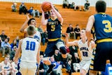 See some of the action and hear a remark from DeWitt's Mason Gilbert following a win over Ionia on Feb. 5, 2019.