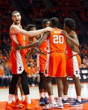 Feb 5, 2019; Champaign, IL, USA; Illinois Fighting Illini forward Giorgi Bezhanishvili (15), guard Ayo Dosunmu (11), forward Kipper Nichols (2), guard Andres Feliz (10), and guard Da'Monte Williams (20) await the end of a timeout during the second half against the Michigan State Spartans at State Farm Center. Mandatory Credit: Mike Granse-USA TODAY Sports