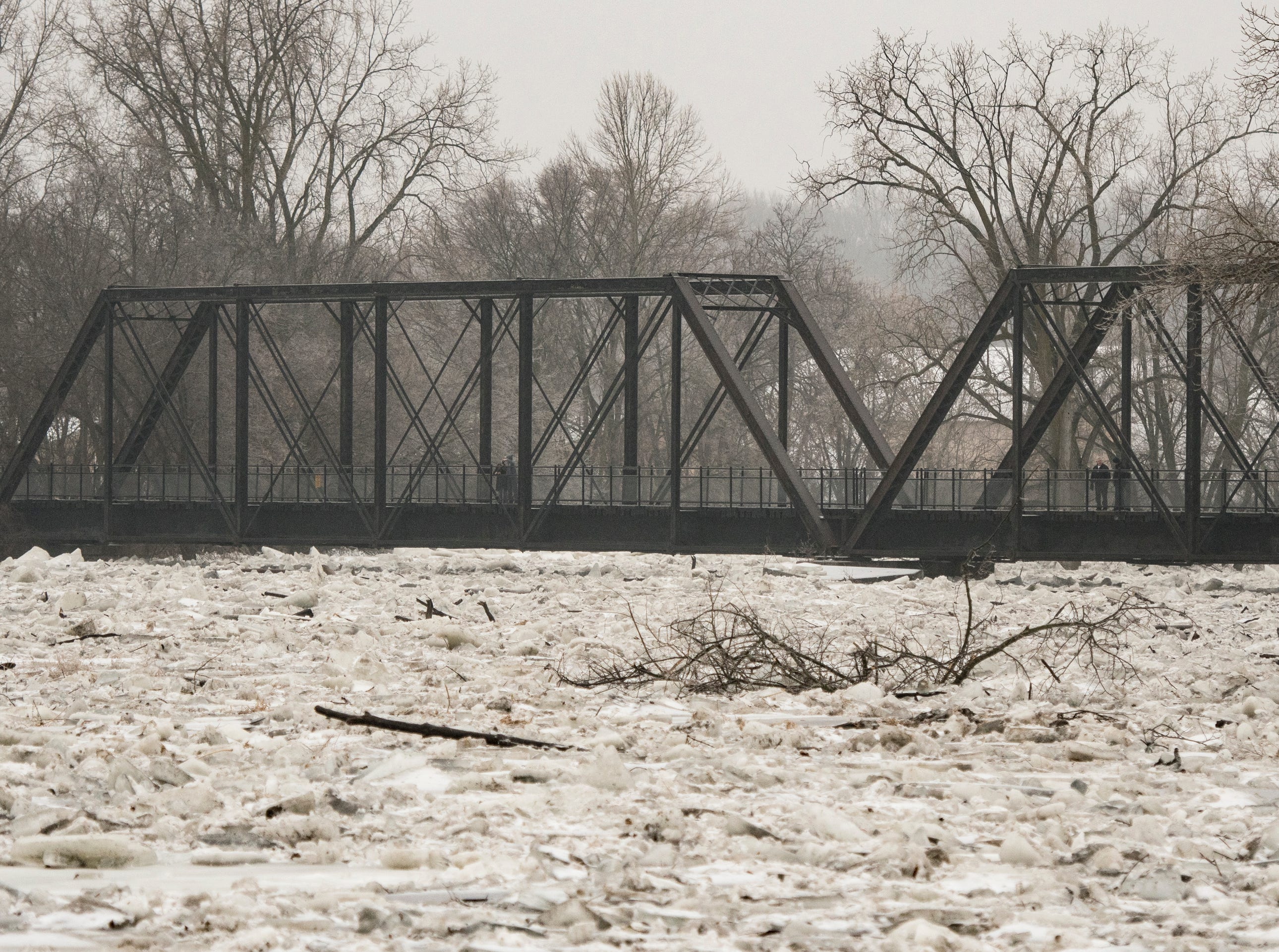 The trussle on the Grand River near downtown Portland, Michigan seen Wednesday morning, Feb. 6, 2019.  About 50 people were evacuated late Tuesday evening through early Wednesday morning due to flooding along the Grand River caused by melting snow and an ice jam in the river.  [Matthew Dae Smith/Lansing State Journal]