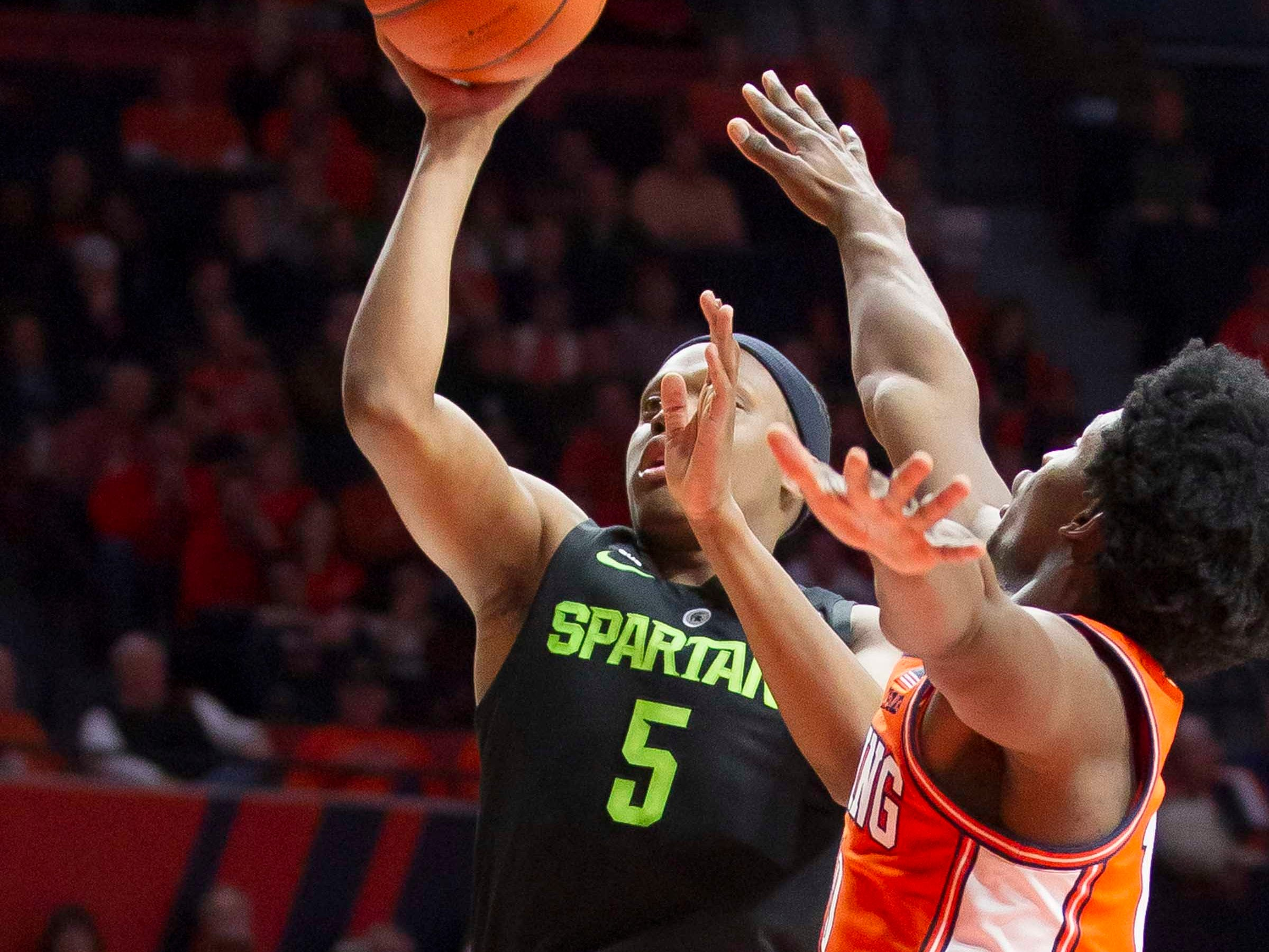 Feb 5, 2019; Champaign, IL, USA; Michigan State Spartans guard Cassius Winston (5) shoots defended by Illinois Fighting Illini guard Andres Feliz (10) during the second half at State Farm Center. Mandatory Credit: Mike Granse-USA TODAY Sports