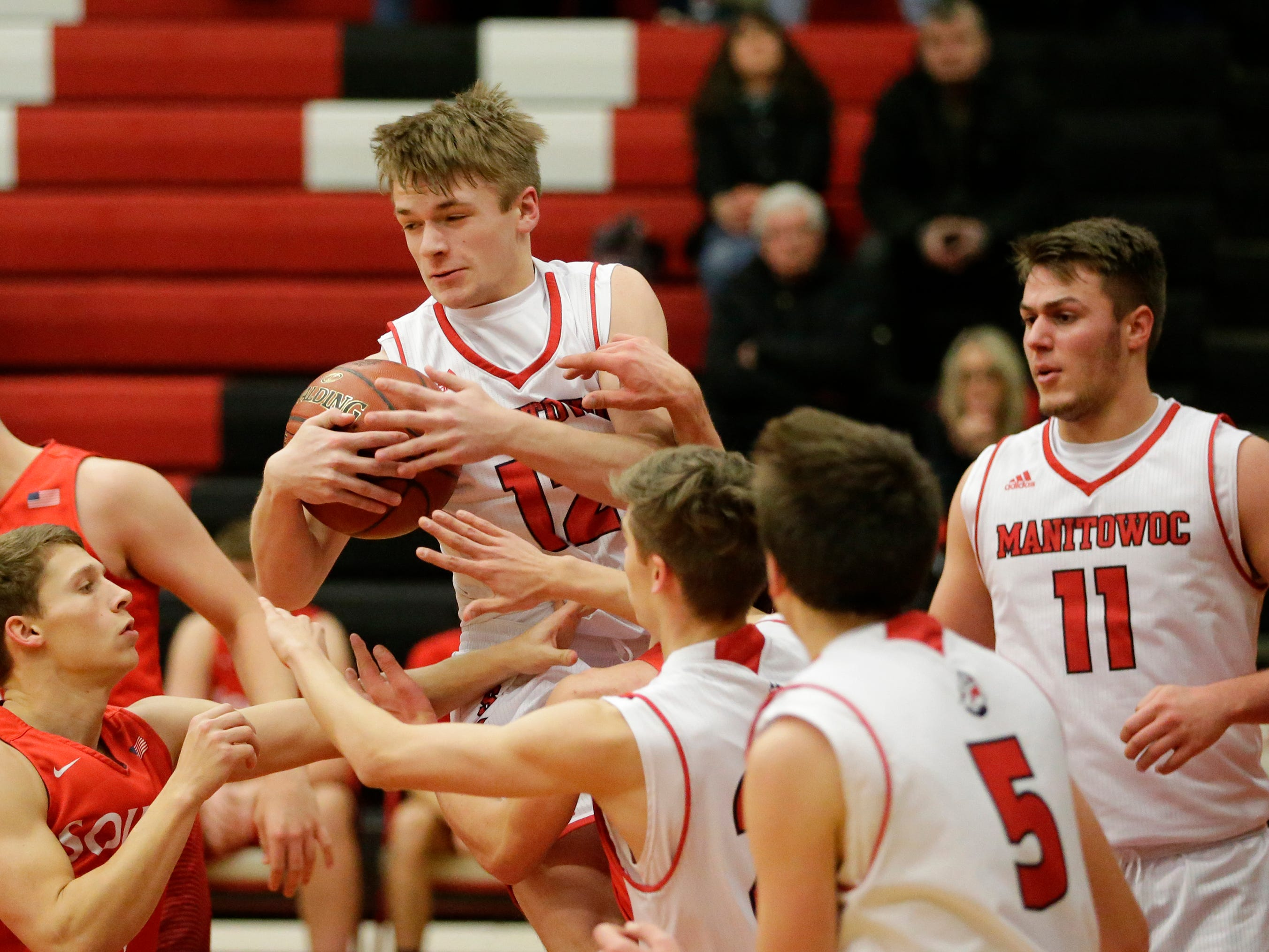 Manitowoc Lincoln's Gage Cornell (12) rebounds against Sheboygan South at Manitowoc Lincoln High School Tuesday, February 5, 2019, in Manitowoc, Wis. Joshua Clark/USA TODAY NETWORK-Wisconsin