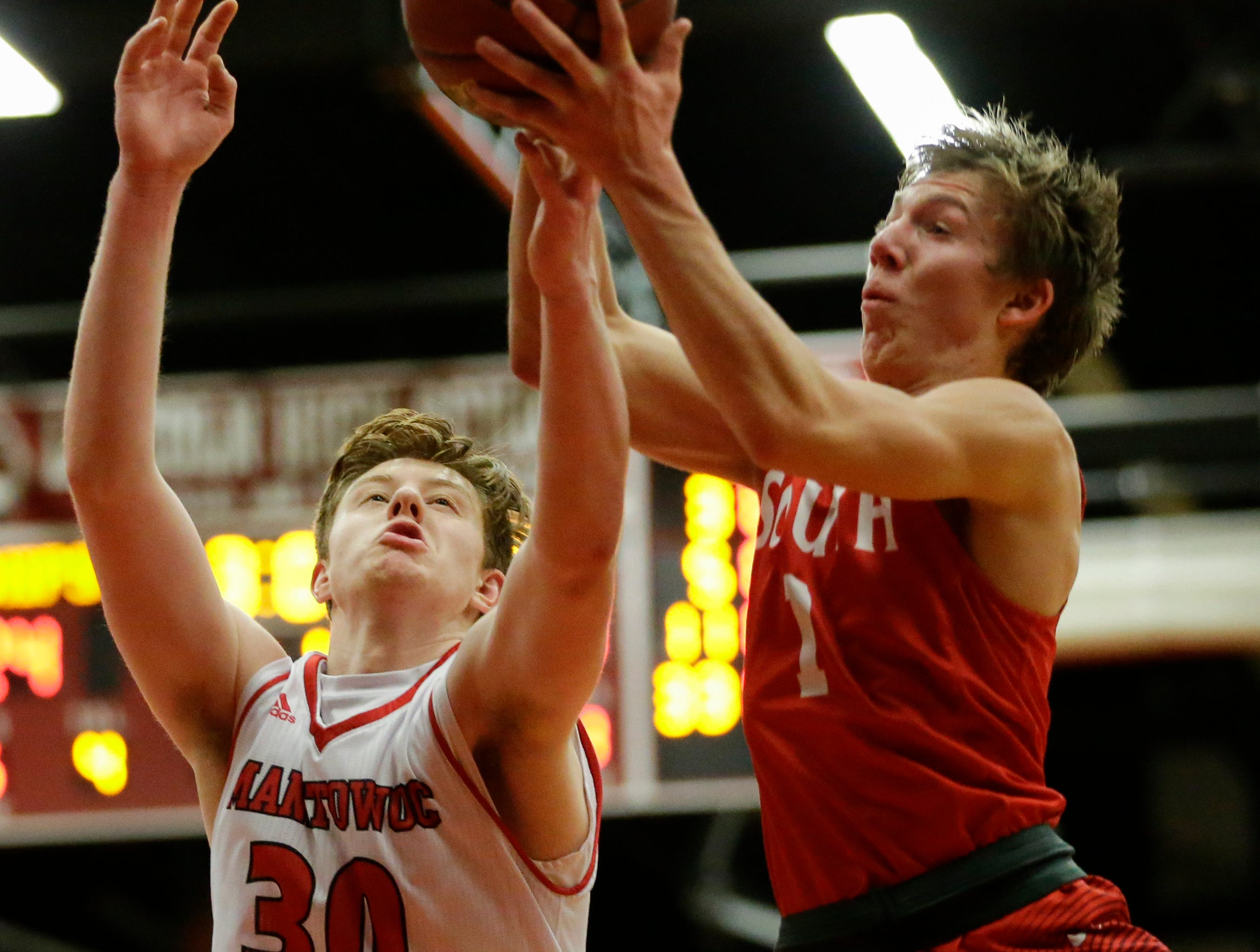 Sheboygan South's Austin Boeldt (1) battles Manitowoc Lincoln's Alec Messman (30) for a rebound at Manitowoc Lincoln High School Tuesday, February 5, 2019, in Manitowoc, Wis. Joshua Clark/USA TODAY NETWORK-Wisconsin