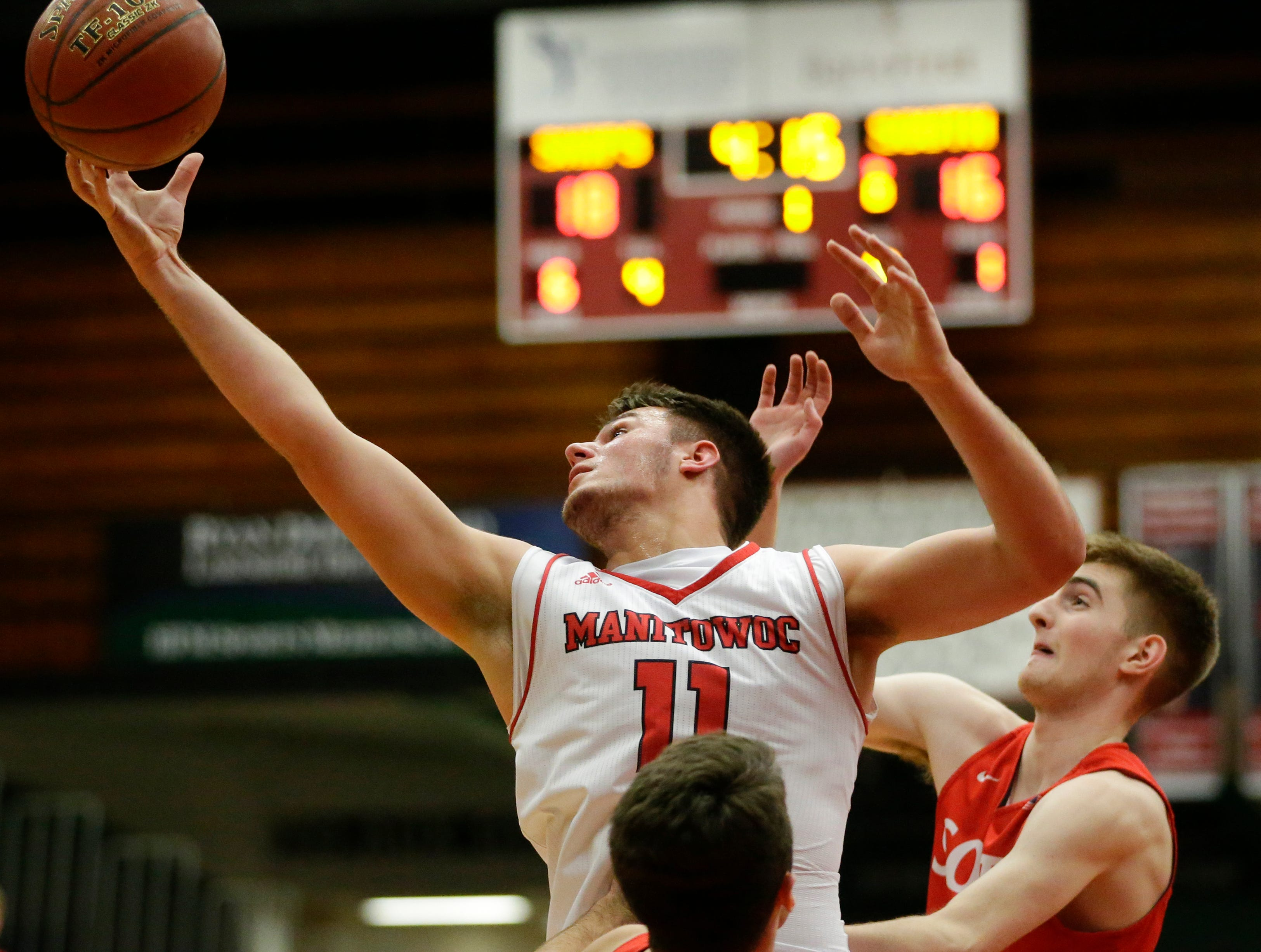 Manitowoc Lincoln's Davis Heinzen (11) reaches for a rebound against Sheboygan South at Manitowoc Lincoln High School Tuesday, February 5, 2019, in Manitowoc, Wis. Joshua Clark/USA TODAY NETWORK-Wisconsin