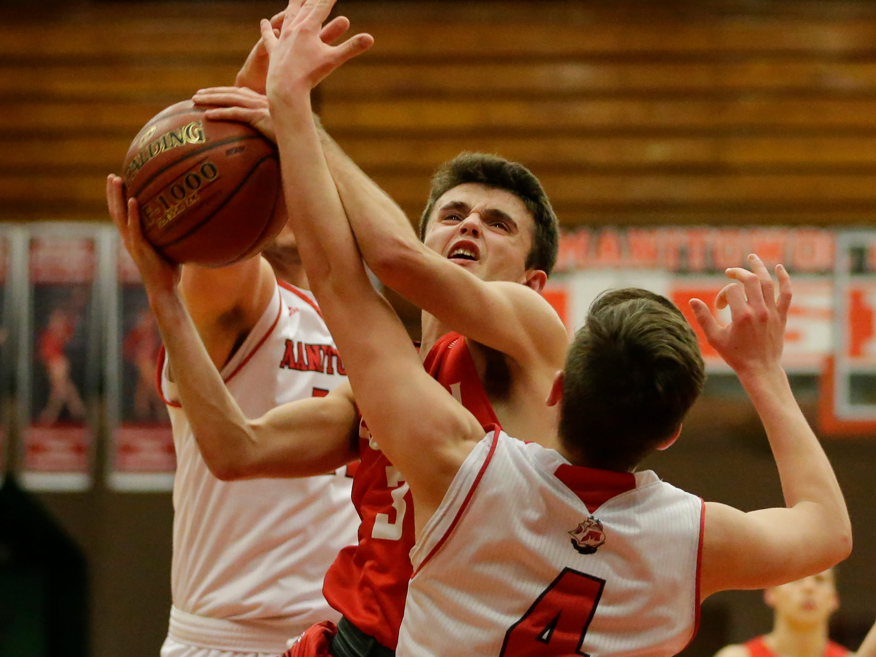 Sheboygan South's Josh Govek (3) puts up a shot against Manitowoc Lincoln's Mason Dopirak (4) at Manitowoc Lincoln High School Tuesday, February 5, 2019, in Manitowoc, Wis. Joshua Clark/USA TODAY NETWORK-Wisconsin