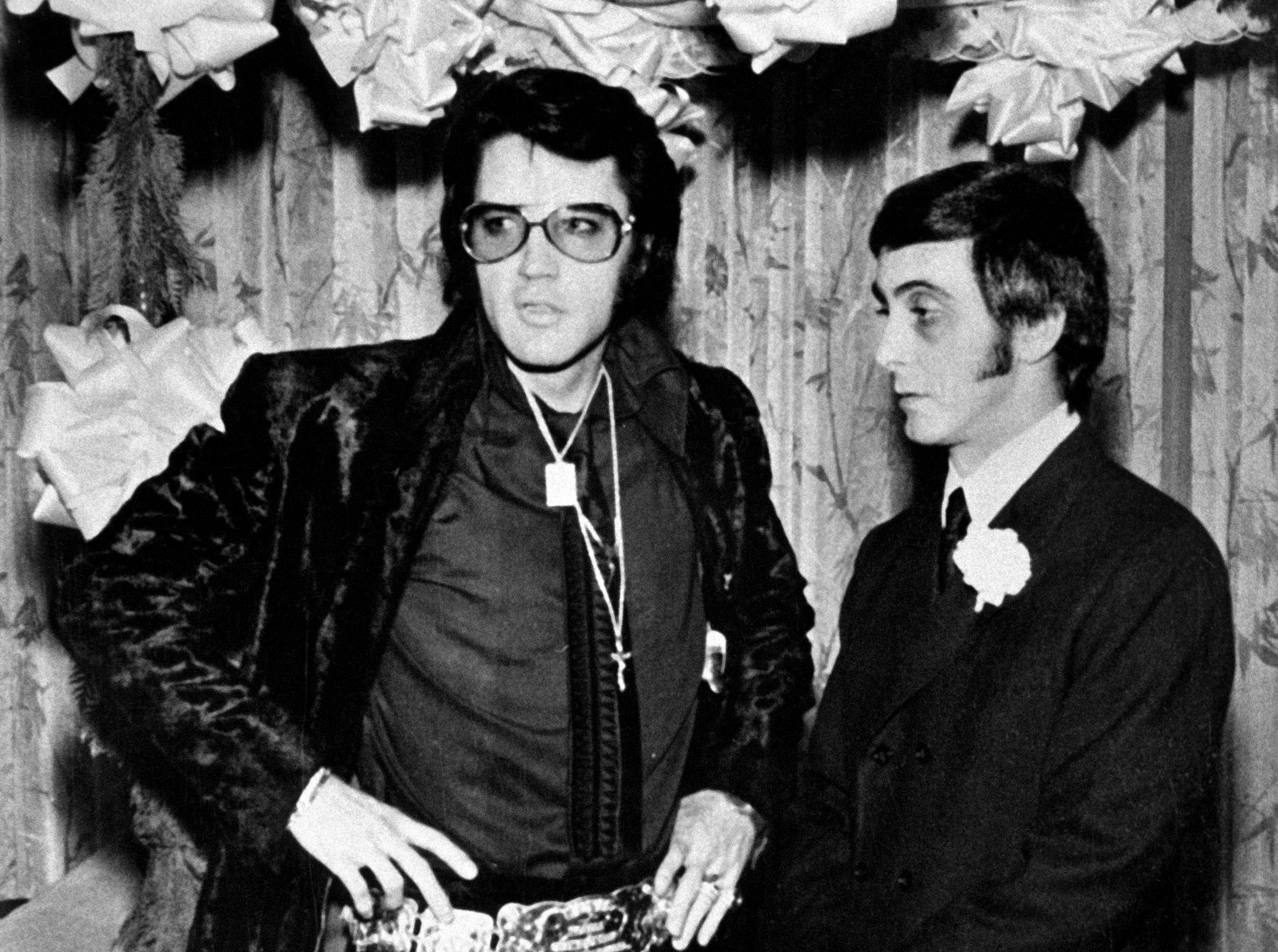 Elvis Presley stands with George Klein while serving as his best man at his wedding on December 5, 1970.
