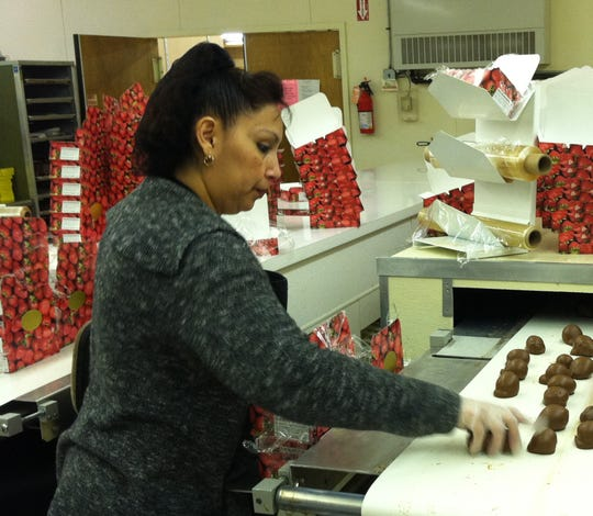At Dinstuhl's, each box of chocolate covered strawberries is packed by hand.